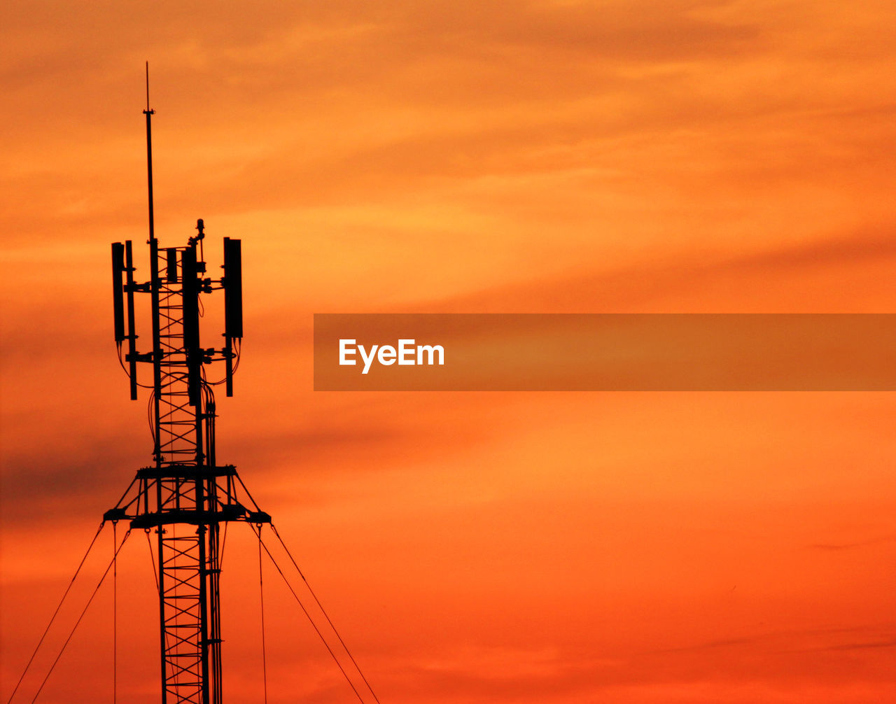 orange color, sky, sunset, technology, cloud - sky, architecture, built structure, no people, connection, silhouette, communication, nature, beauty in nature, low angle view, tower, antenna - aerial, outdoors, scenics - nature, tall - high, global communications