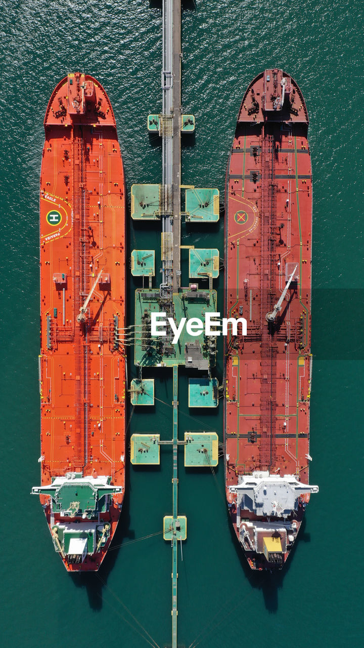 Directly above shot of cargo ships moored by offshore platform