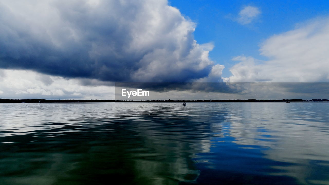 water, sky, cloud - sky, tranquility, beauty in nature, scenics, tranquil scene, no people, nature, outdoors, reflection, waterfront, day, sea