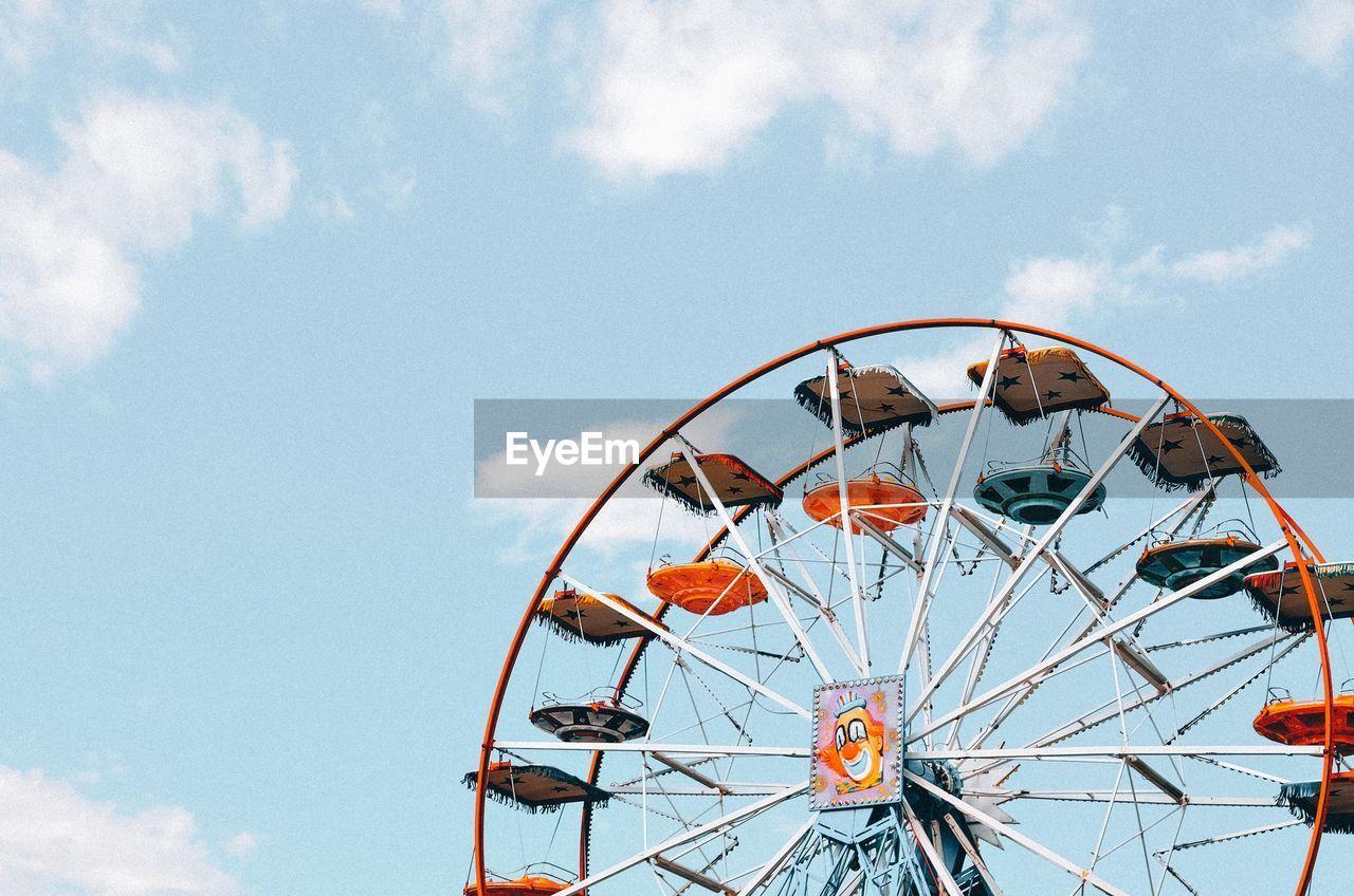 ferris wheel, amusement park ride, sky, amusement park, cloud - sky, low angle view, arts culture and entertainment, nature, day, no people, metal, circle, fairground, shape, geometric shape, outdoors, traveling carnival, carnival, leisure activity, built structure, wheel