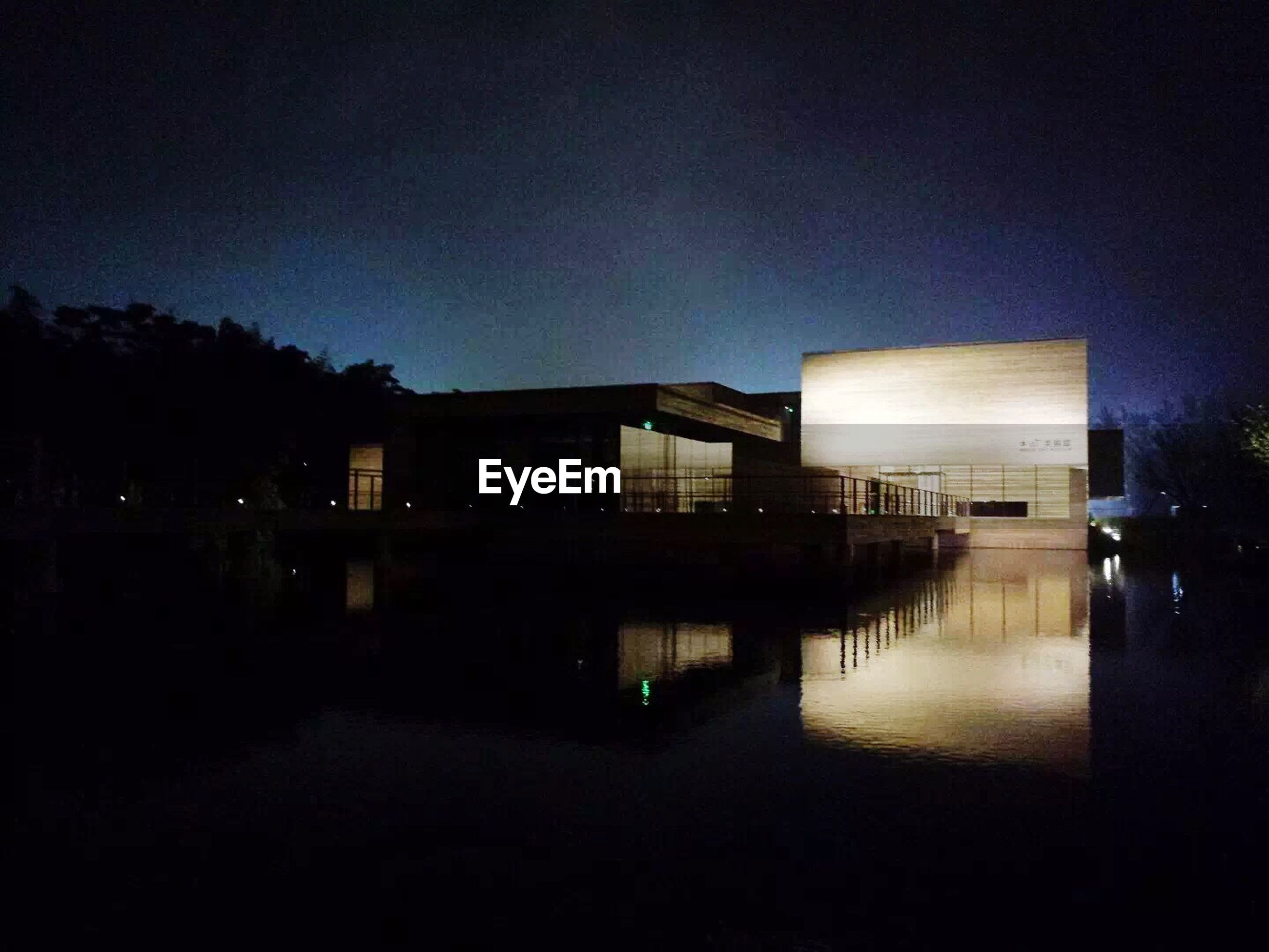 architecture, built structure, building exterior, night, water, illuminated, reflection, house, clear sky, copy space, waterfront, tree, dark, sky, lake, river, dusk, tranquility, outdoors, no people