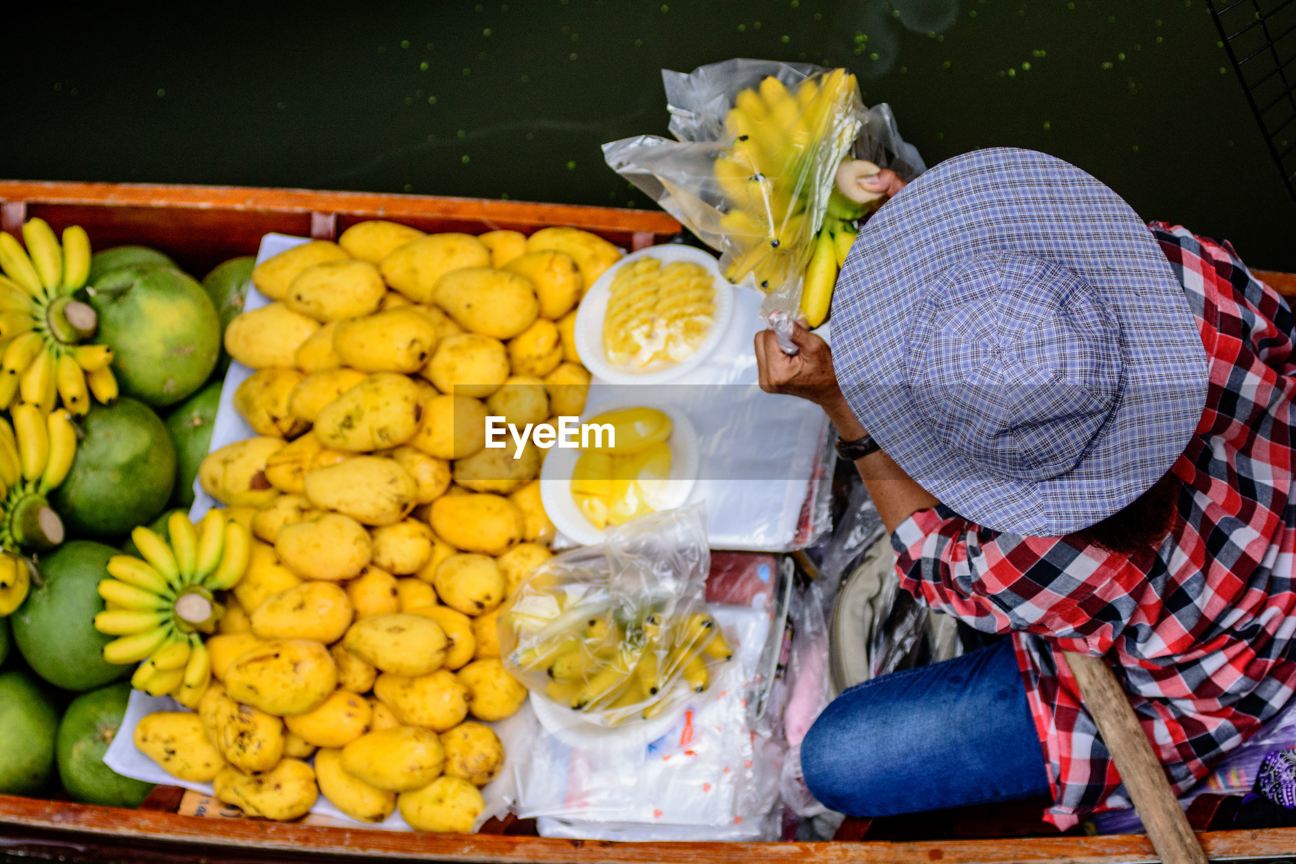 Man selling fruits on boat