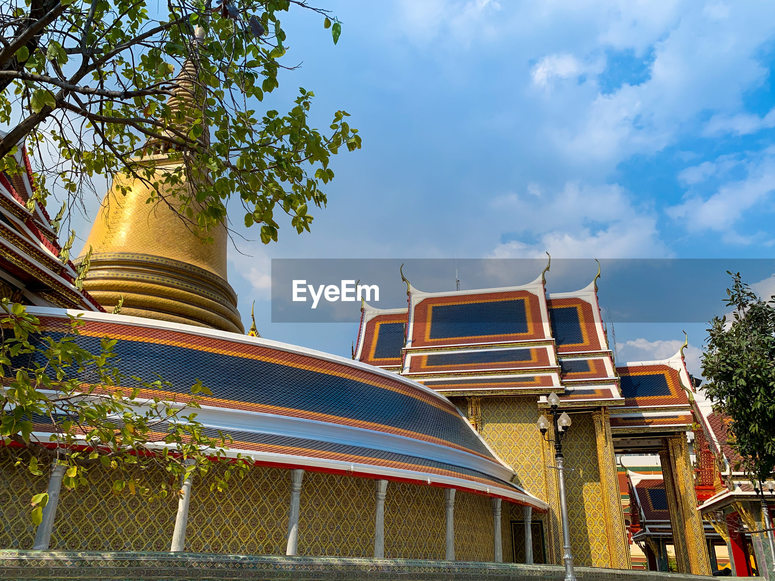 Low angle view of traditional thai building against sky
