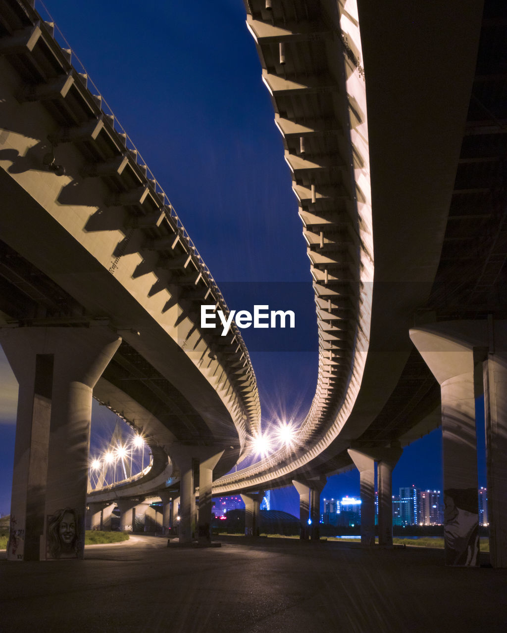 built structure, architecture, connection, illuminated, sky, bridge, transportation, night, bridge - man made structure, no people, road, nature, architectural column, city, low angle view, building exterior, outdoors, communication, blue