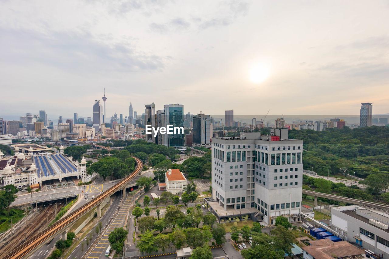 High Angle View Of Tracks Along Buildings
