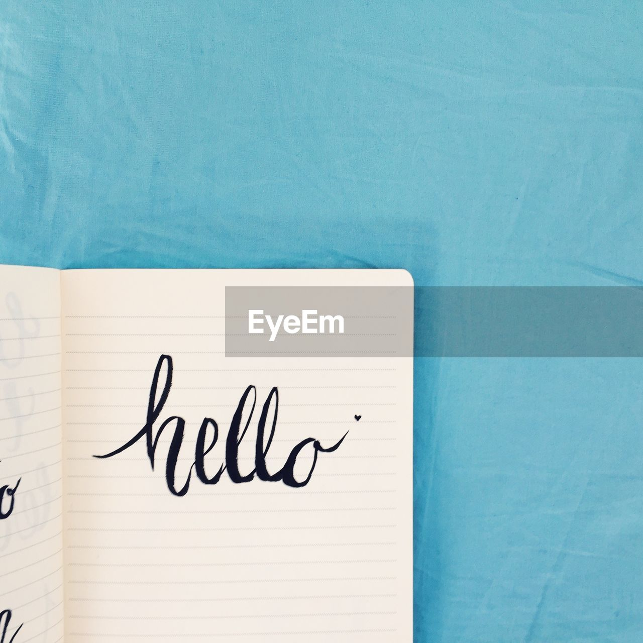 High Angle View Of Hello Text On Paper