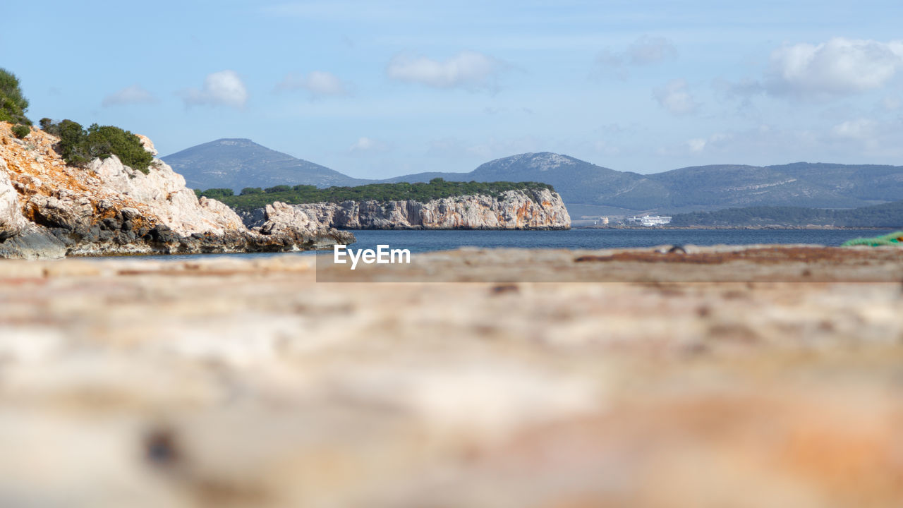 water, sea, sky, scenics - nature, mountain, beauty in nature, land, tranquil scene, tranquility, beach, day, nature, cloud - sky, no people, rock, idyllic, outdoors, non-urban scene, solid