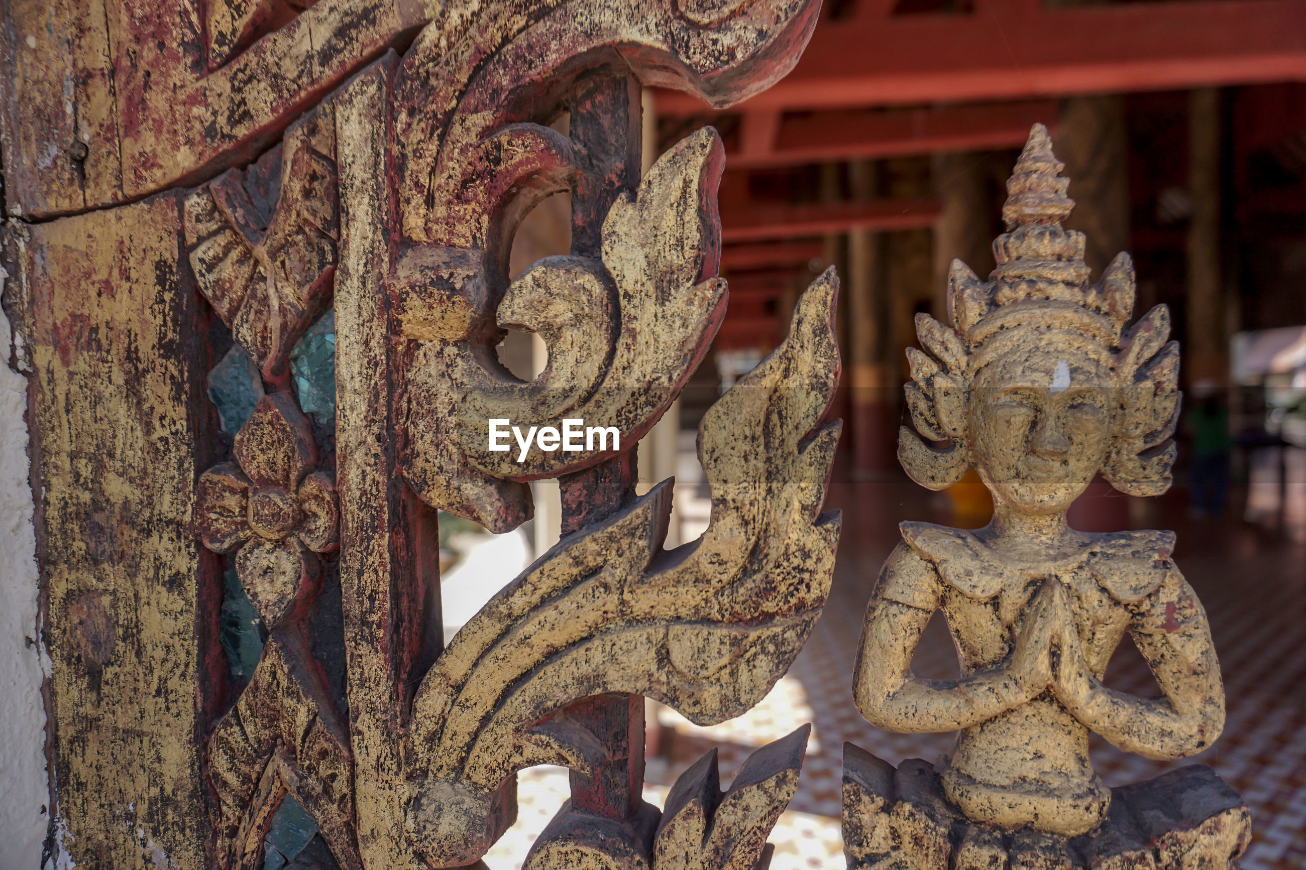 Close-up of sculptures on temple inside building