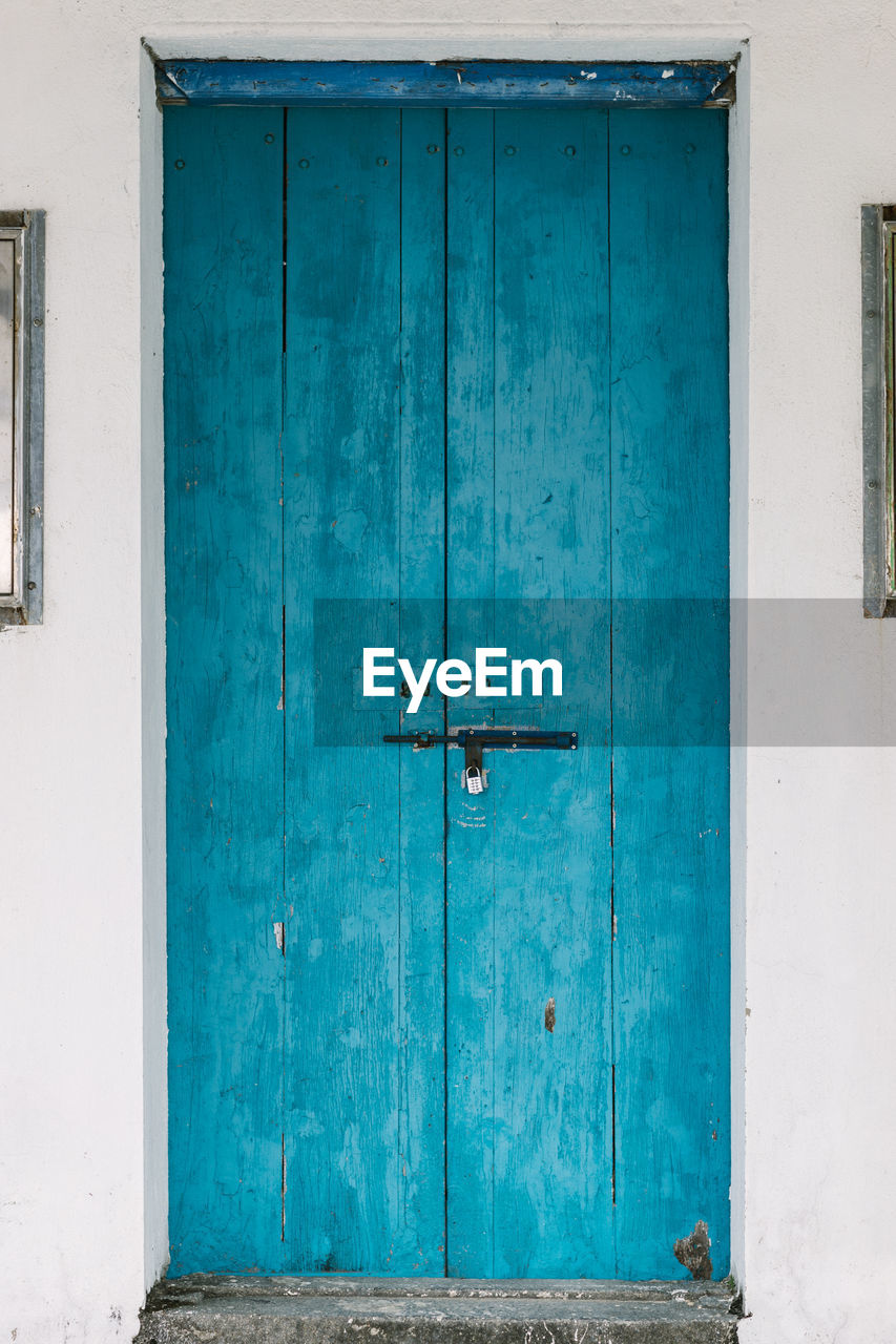 door, closed, protection, entrance, safety, security, blue, architecture, wood - material, outdoors, no people, built structure, old-fashioned, doorway, day, lock, entry, building exterior, hinge, close-up