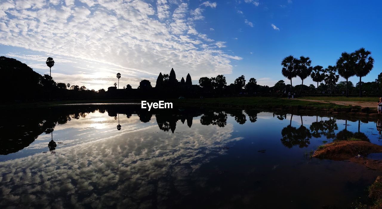 reflection, water, sky, lake, silhouette, tree, nature, cloud - sky, plant, architecture, tranquility, built structure, waterfront, sunset, building exterior, scenics - nature, no people, beauty in nature, tranquil scene, outdoors, reflection lake