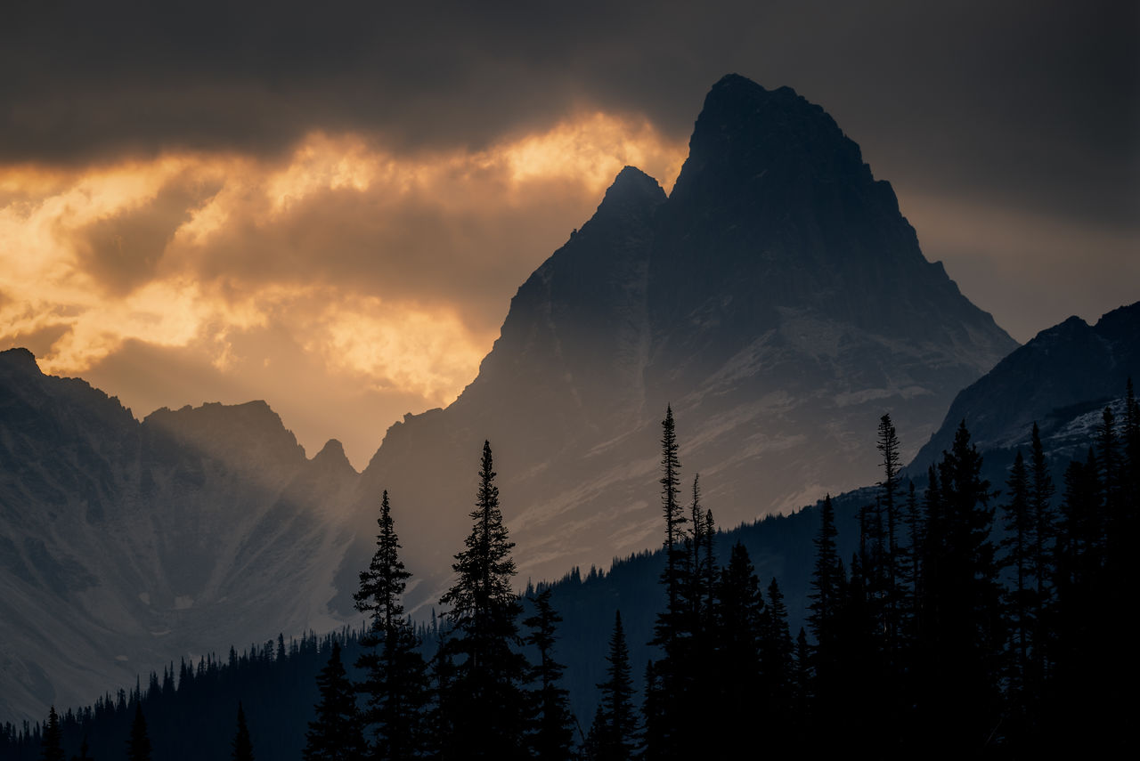 Panoramic View Of Silhouette Mountains Against Sky At Sunset