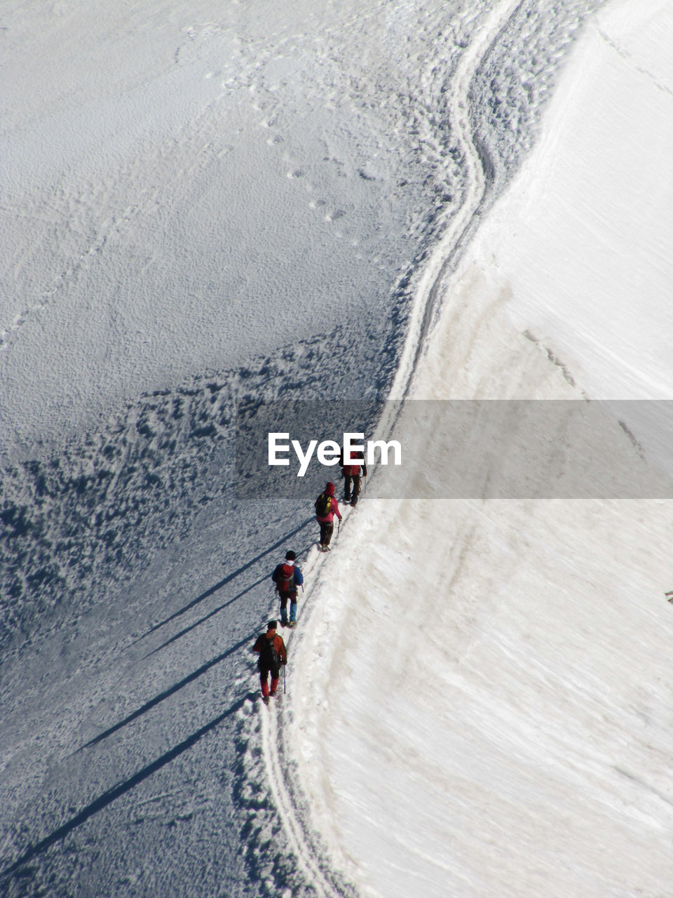 High Angle View Of People Walking In Snow Covered Landscape