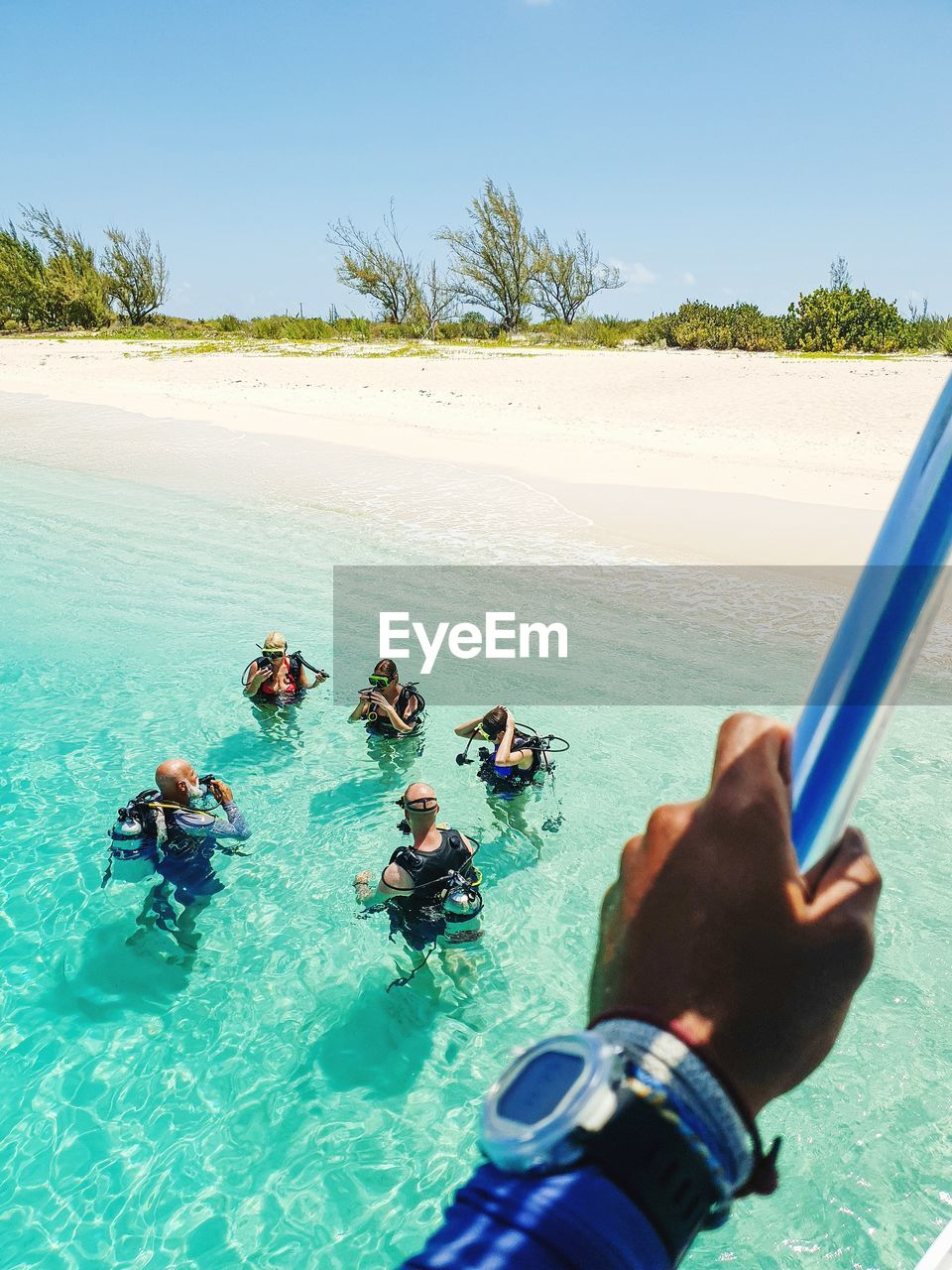 water, real people, sea, leisure activity, lifestyles, sky, land, nature, day, men, group of people, people, beach, aquatic sport, holiday, clear sky, sport, trip, beauty in nature, outdoors