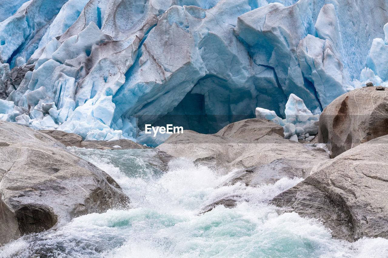 Breaking Wave Against Majestic Glaciers In Norway