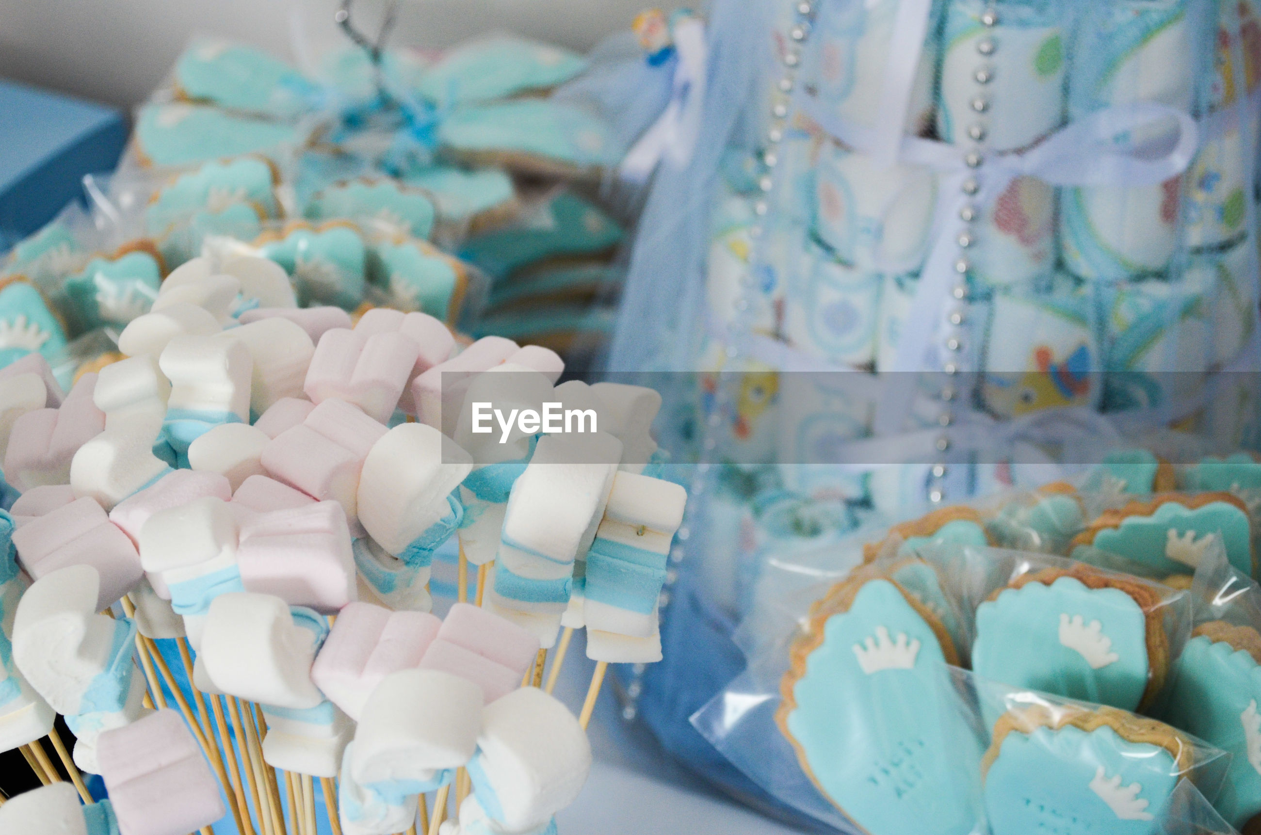 Close-up of marshmallows and cakes for sale in store