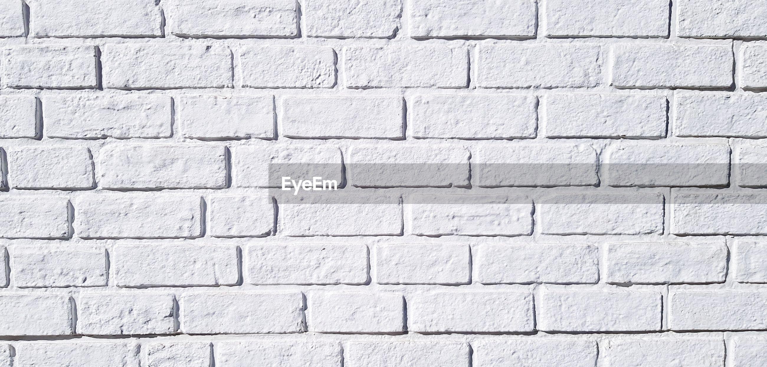 Full frame shot of white brick wall for background