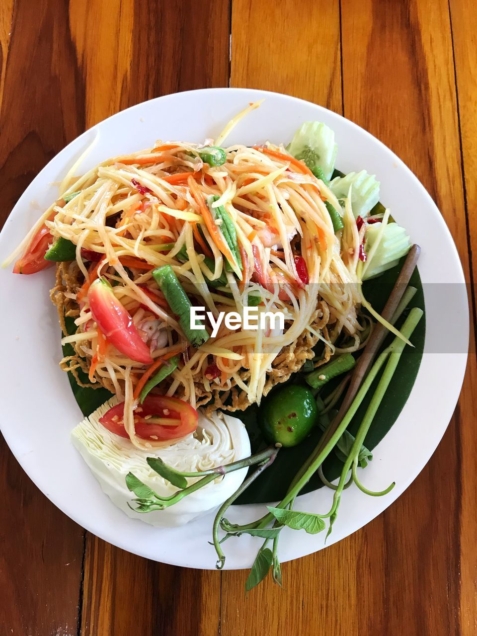 food and drink, food, freshness, table, healthy eating, ready-to-eat, wellbeing, pasta, serving size, vegetable, italian food, indoors, still life, plate, high angle view, wood - material, no people, meal, close-up, directly above, spaghetti, crockery, vegetarian food