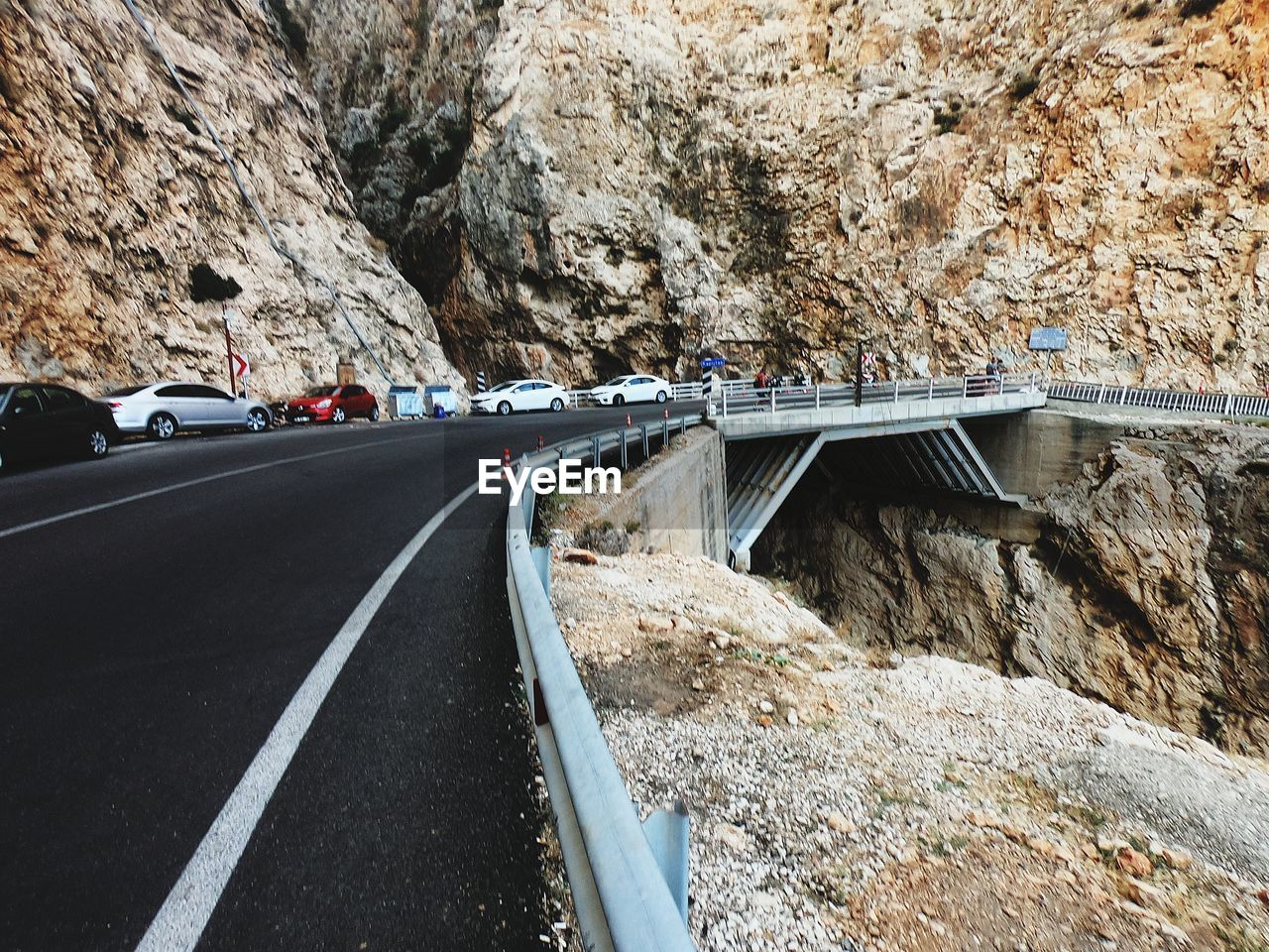 transportation, road, rock, solid, rock - object, mode of transportation, nature, motor vehicle, connection, car, day, land vehicle, mountain, no people, rock formation, motion, outdoors, sign, bridge - man made structure, bridge, formation