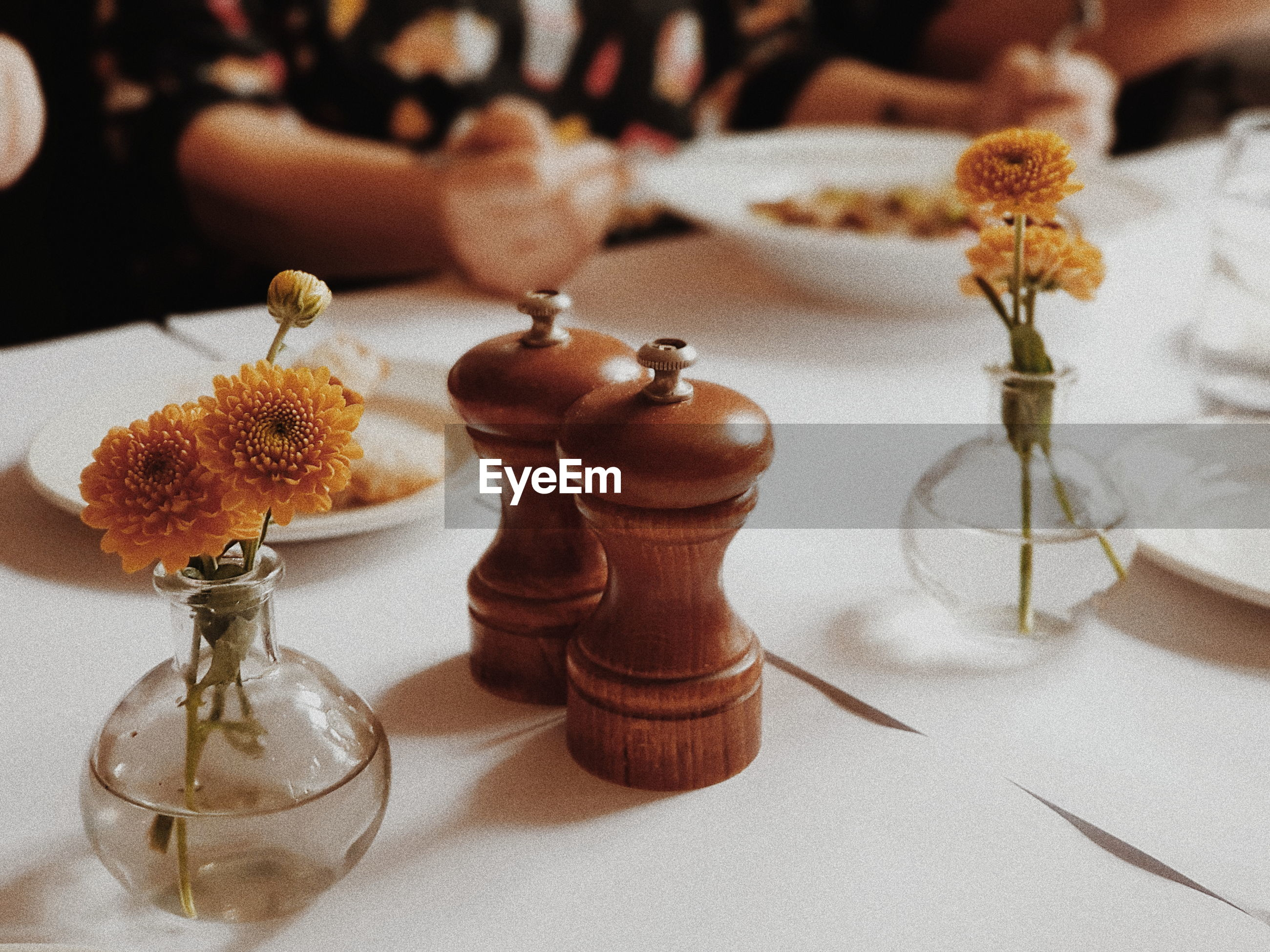 High angle view of shakers with flower vases on table