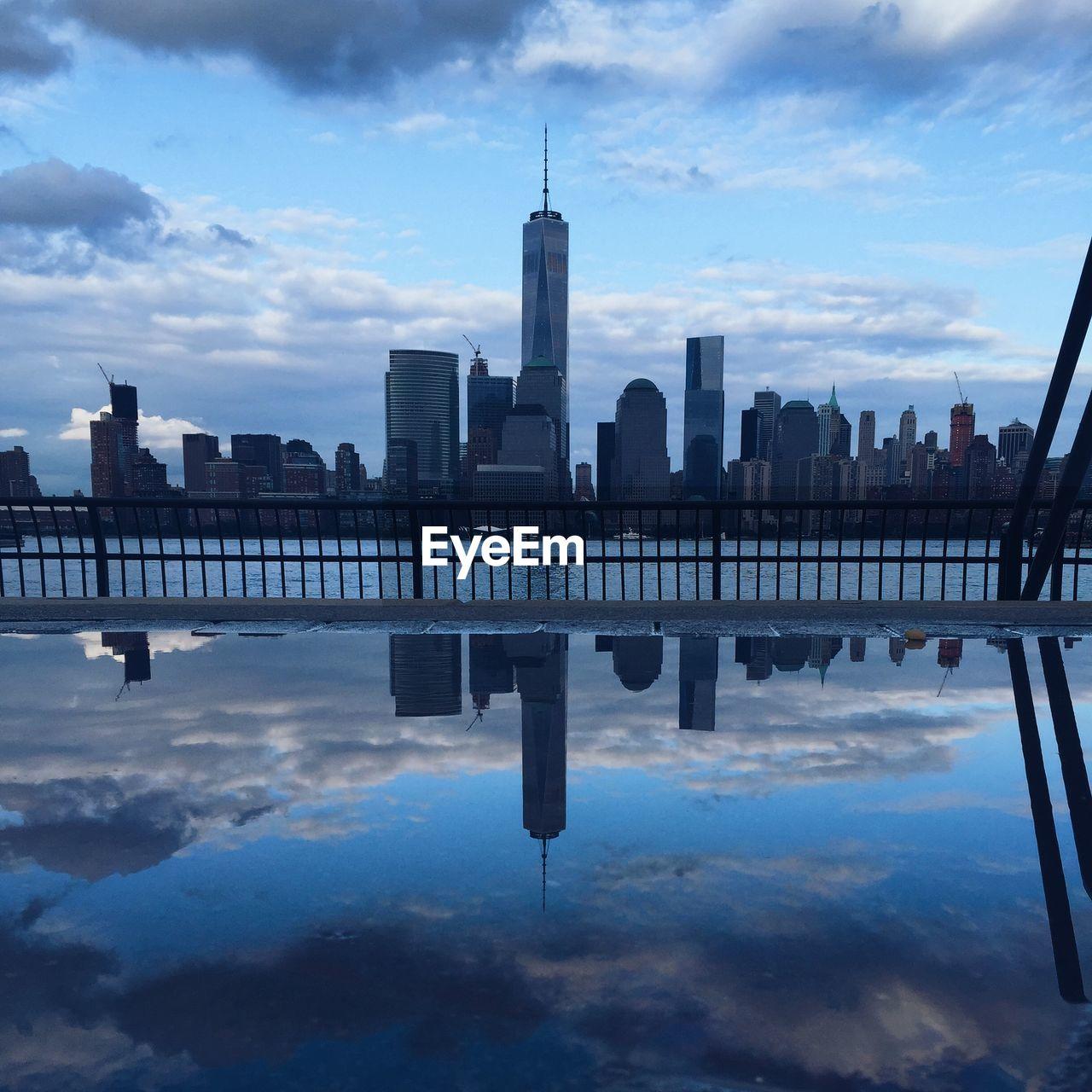 Reflection Of Urban Skyline On Water