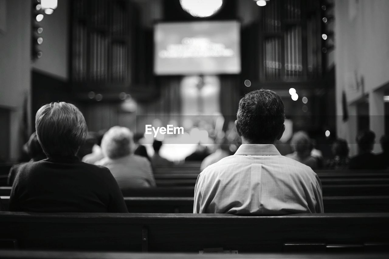 Rear view of people sitting on benches in la crescenta presbyterian church