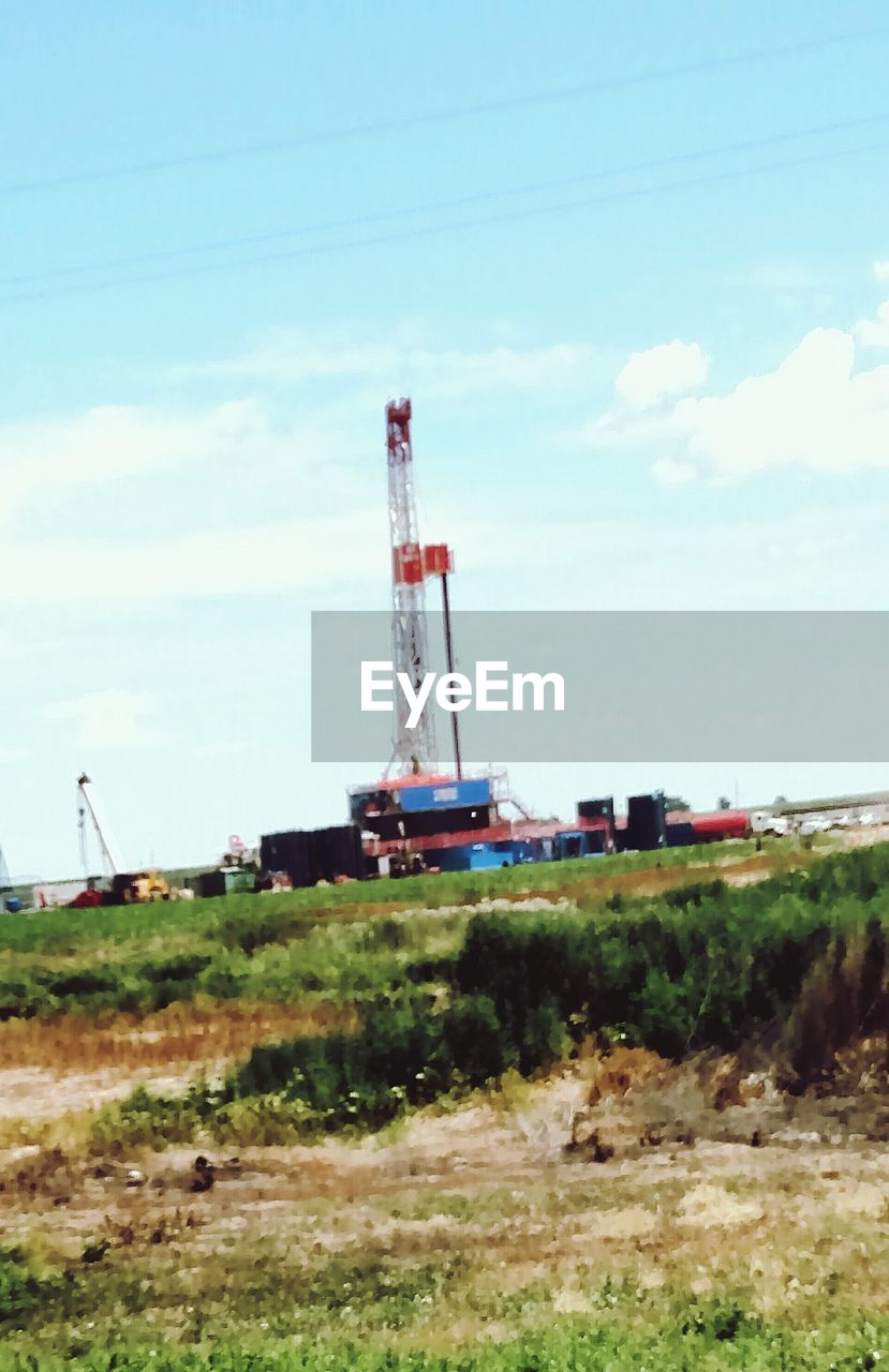 industry, sky, day, oil industry, field, cloud - sky, no people, fuel and power generation, built structure, architecture, technology, outdoors, industrial equipment, drilling rig, oil well, oil pump
