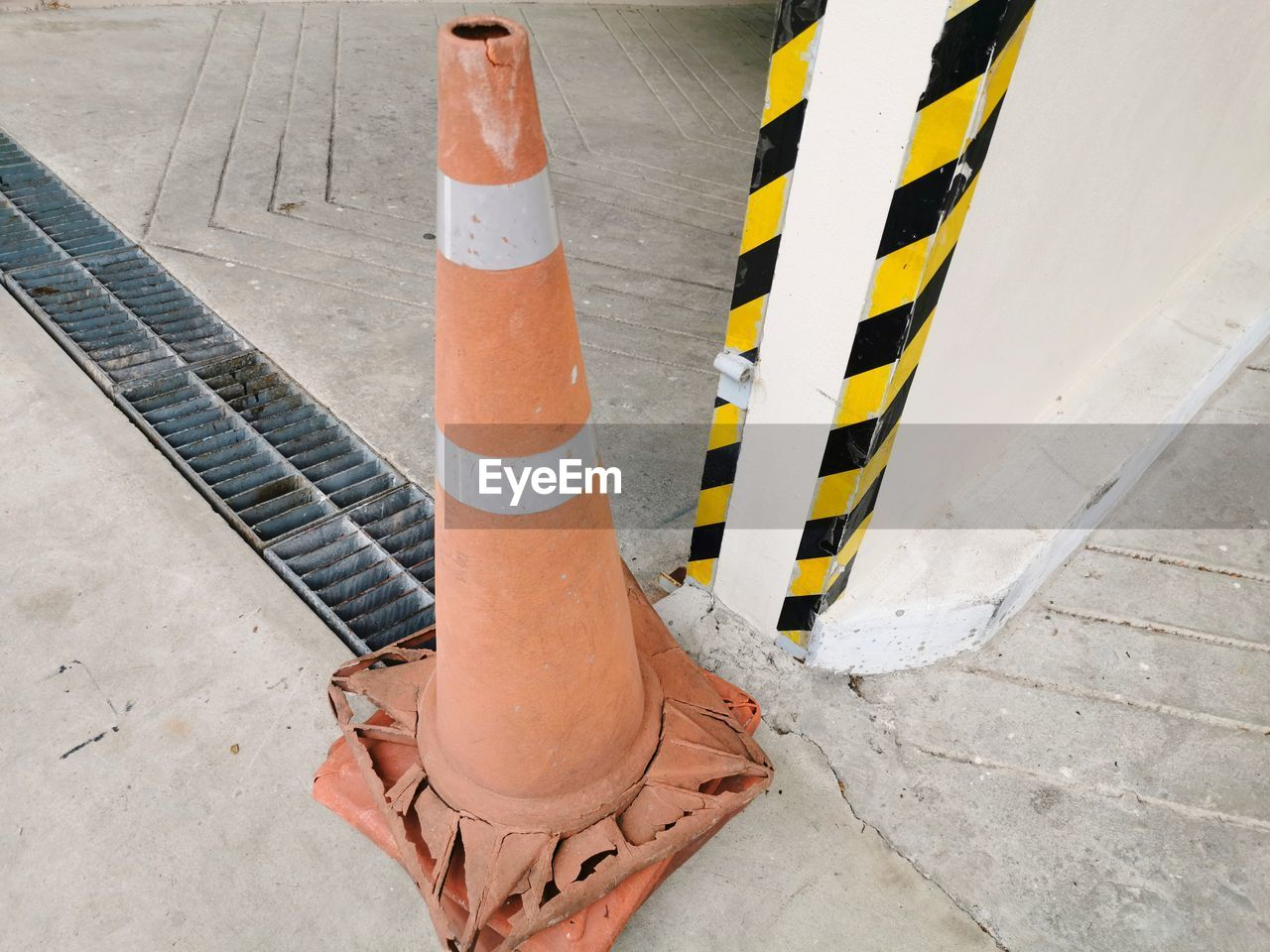 HIGH ANGLE VIEW OF YELLOW STANDING ON FOOTPATH BY CITY