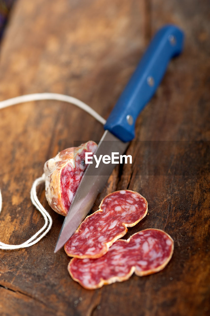 Close Up Of Knife And Meat On Table