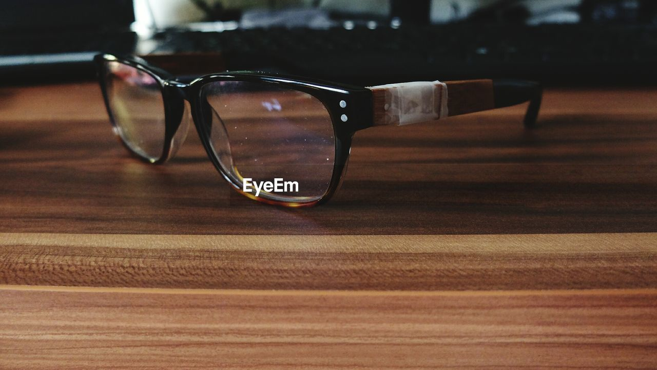 Close-Up Of Glasses On Wooden Table