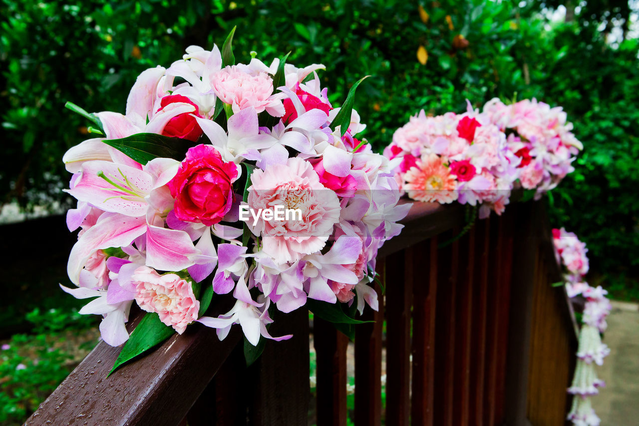 flower, flowering plant, plant, pink color, freshness, fragility, vulnerability, beauty in nature, petal, nature, close-up, flower head, inflorescence, no people, focus on foreground, day, growth, outdoors, wood - material, barrier, springtime, flower arrangement, bouquet