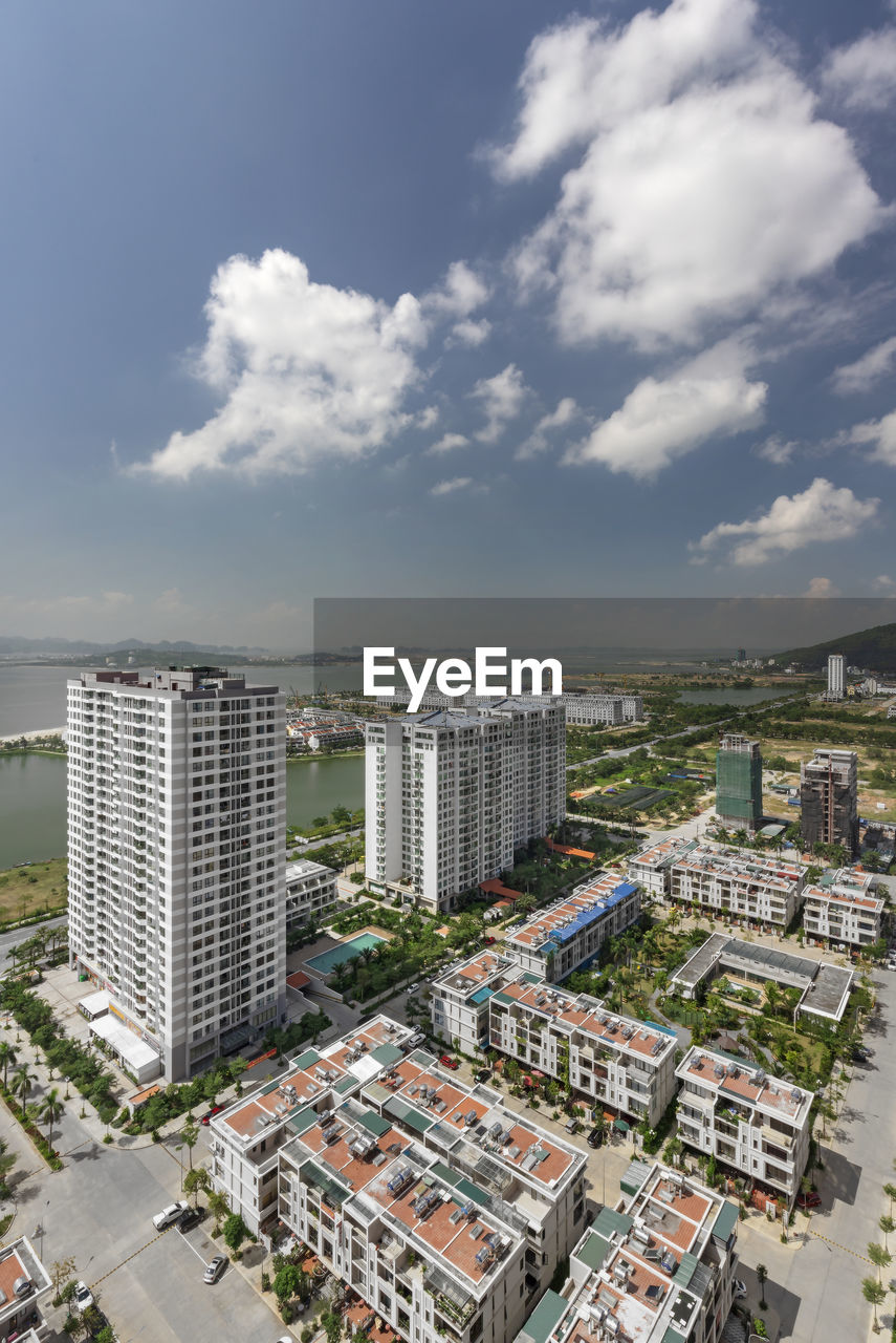 building exterior, cloud - sky, architecture, sky, built structure, city, cityscape, building, high angle view, nature, day, office building exterior, skyscraper, crowded, residential district, outdoors, tall - high, modern