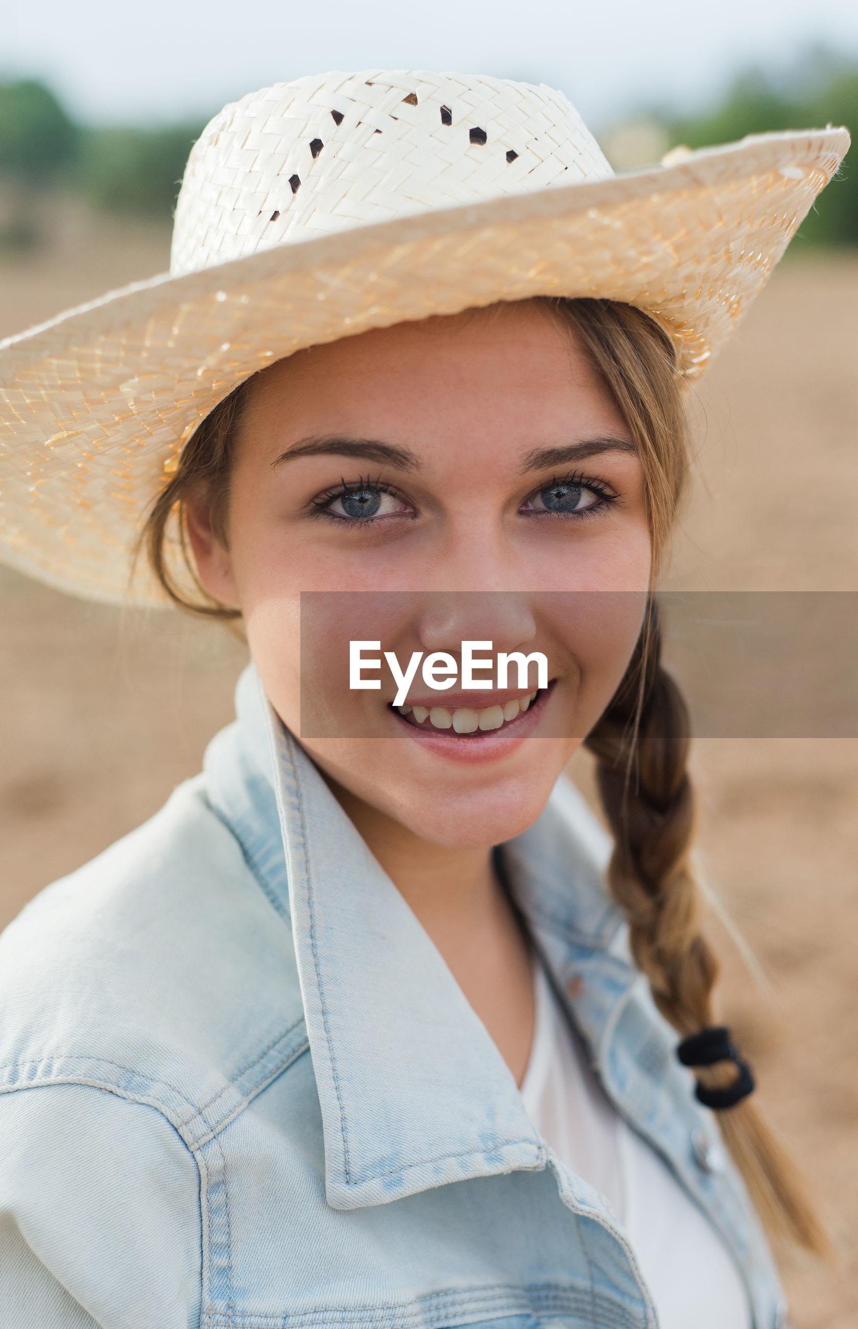 Portrait of smiling woman wearing hat