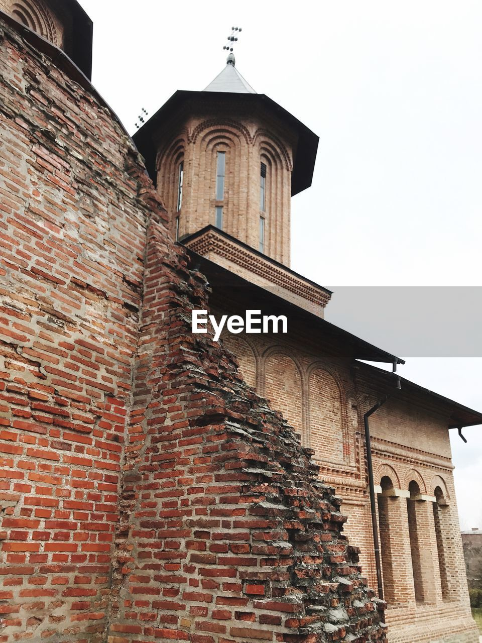 architecture, building exterior, built structure, low angle view, religion, brick wall, place of worship, spirituality, history, no people, outdoors, day, sky