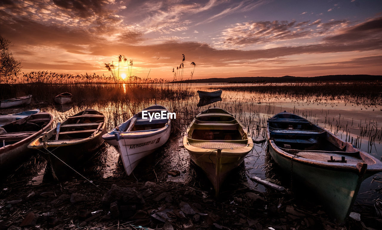sky, sunset, cloud - sky, water, nautical vessel, mode of transportation, transportation, moored, nature, tranquility, scenics - nature, beauty in nature, orange color, tranquil scene, no people, land, lake, outdoors, non-urban scene, rowboat