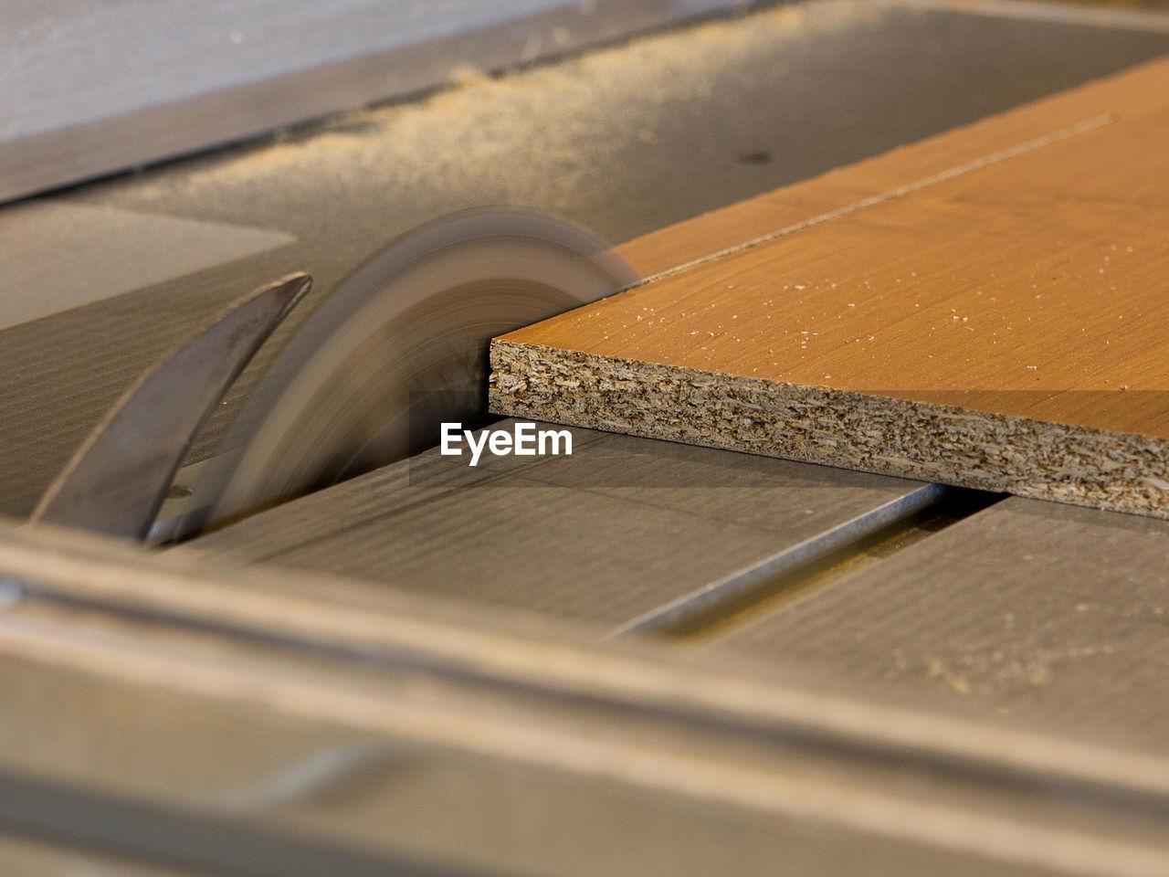 Close-Up Of Wood On Circular Saw