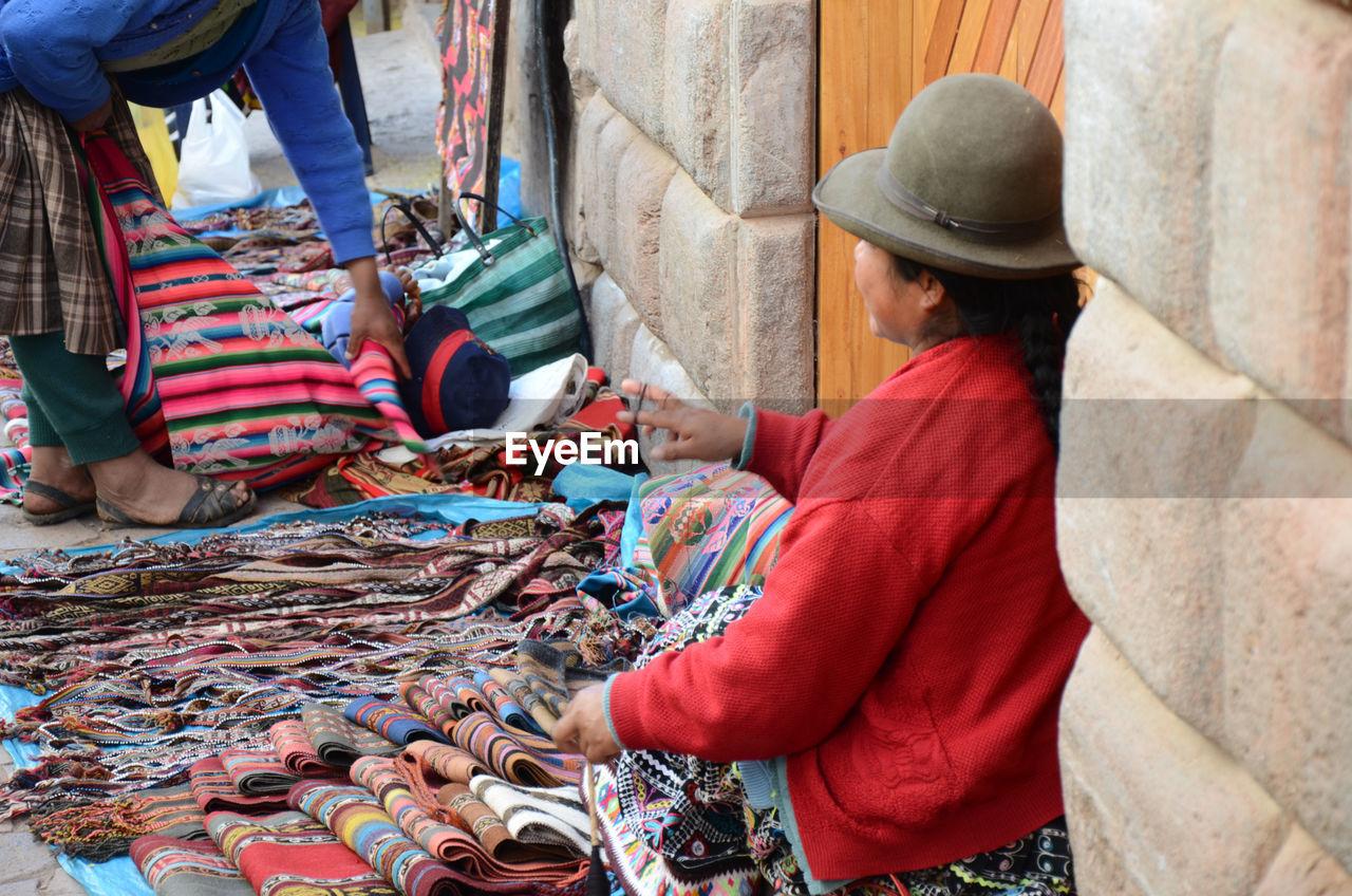 Market vendor selling fabric