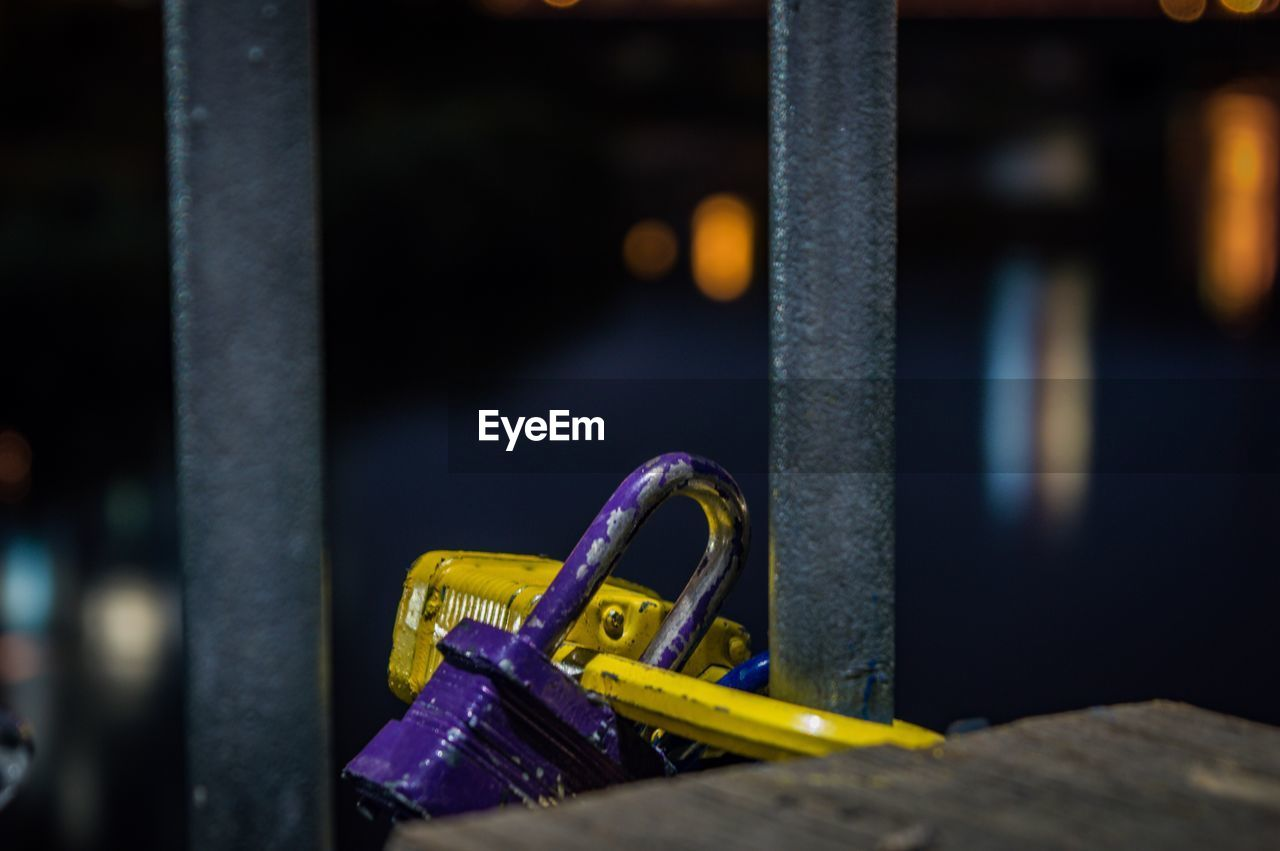 metal, close-up, no people, focus on foreground, safety, indoors, selective focus, security, protection, lock, day, equipment, still life, yellow, blue, connection, hanging, machinery