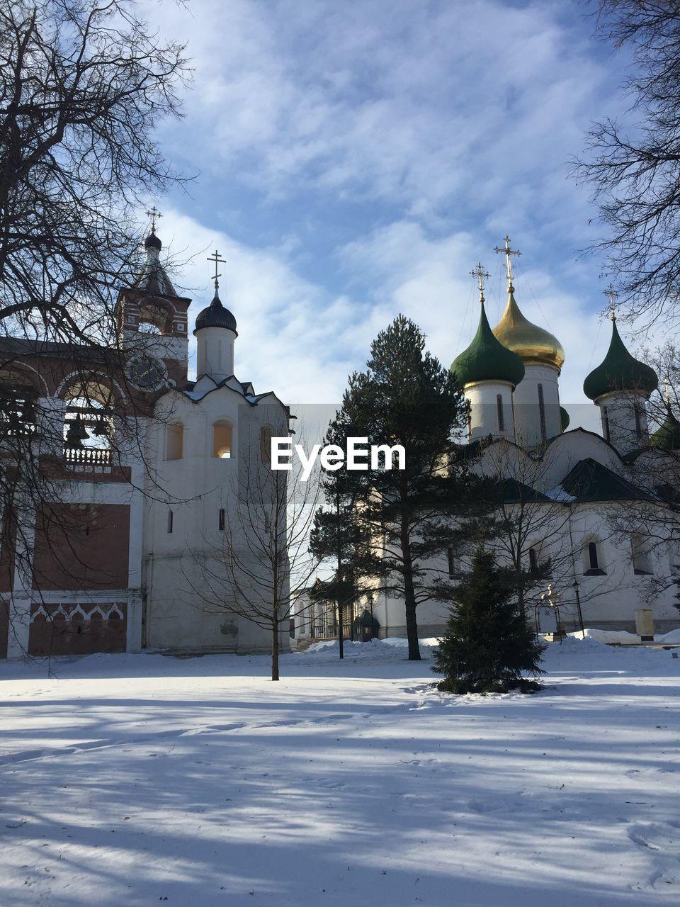 Church On Snow Covered Field Against Sky