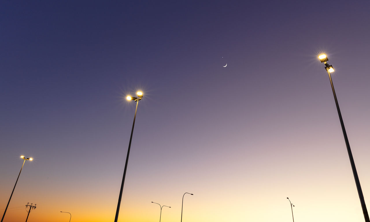 sky, street light, illuminated, lighting equipment, street, low angle view, no people, nature, electricity, sunset, clear sky, technology, moon, pole, dusk, outdoors, glowing, light, floodlight, night, electrical equipment
