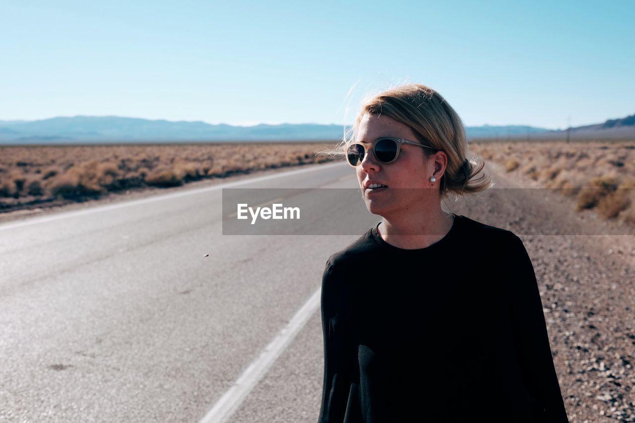 Portrait Of Woman Wearing Sunglasses On Road