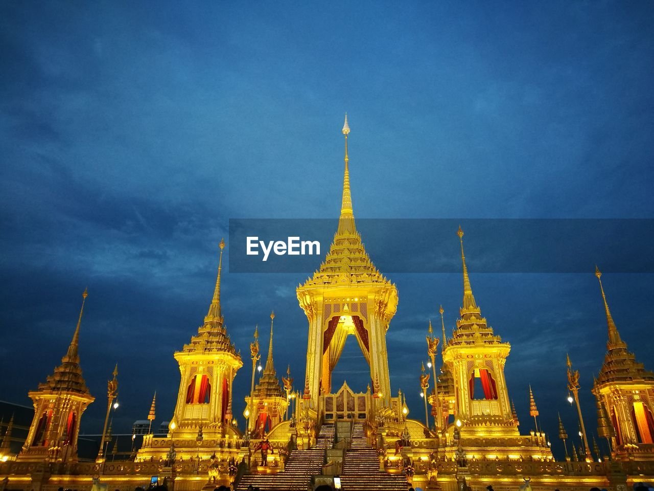 built structure, architecture, religion, belief, spirituality, sky, place of worship, travel destinations, building exterior, gold colored, building, illuminated, no people, nature, dusk, spire, travel, tourism, outdoors