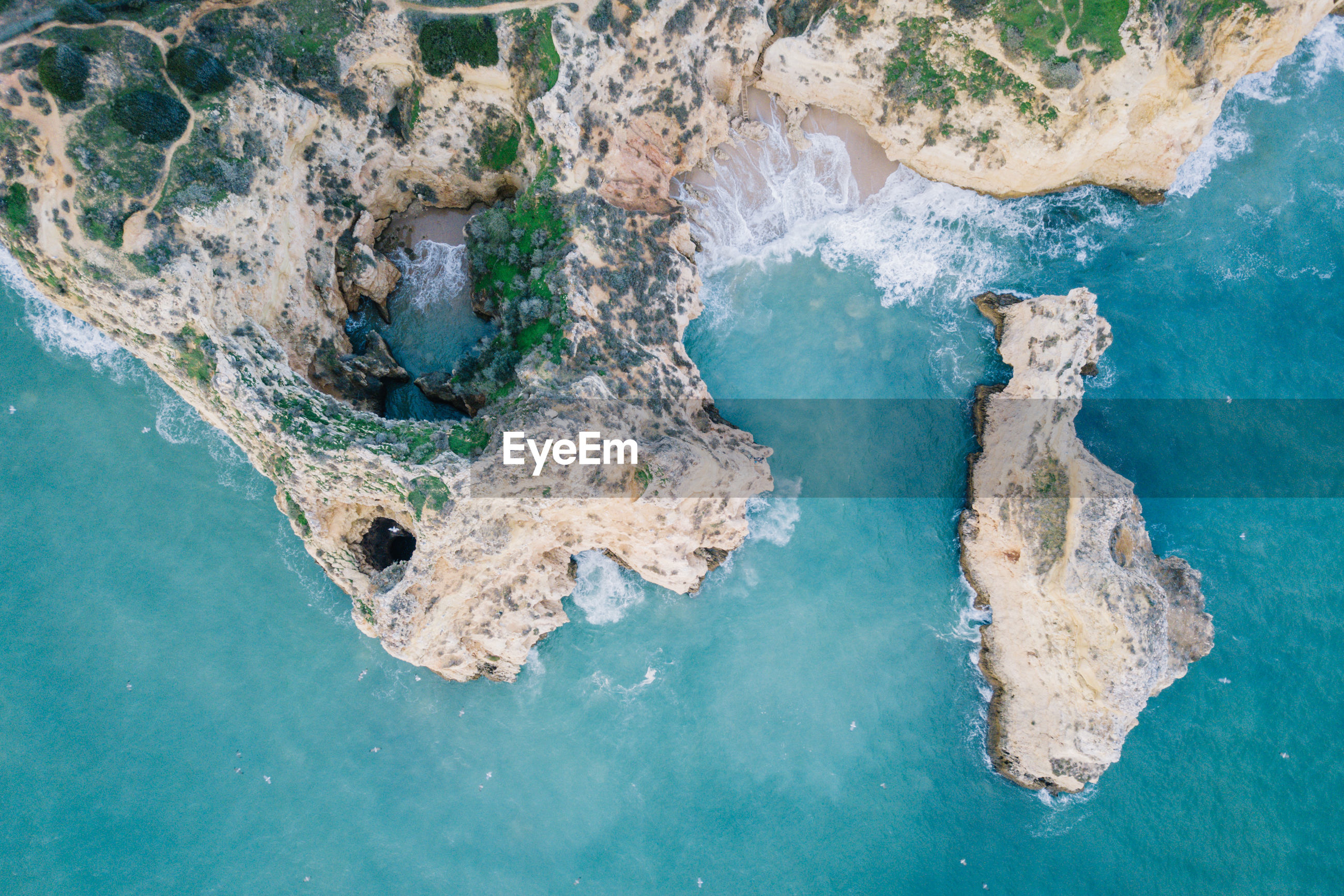 AERIAL VIEW OF ROCK IN SEA