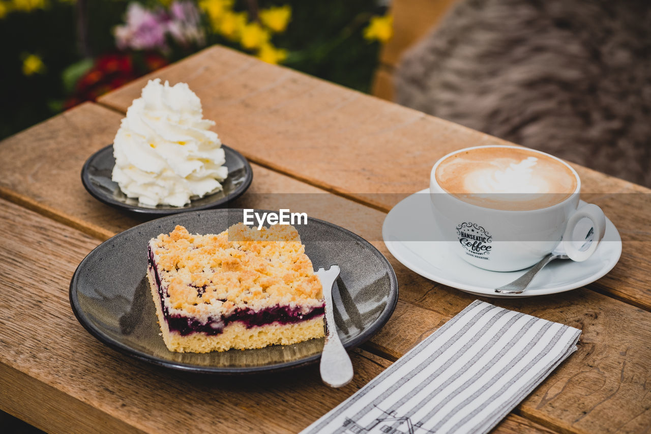 food and drink, table, food, freshness, still life, plate, ready-to-eat, cup, drink, kitchen utensil, eating utensil, mug, refreshment, coffee, no people, serving size, coffee cup, coffee - drink, saucer, focus on foreground, crockery, hot drink, temptation