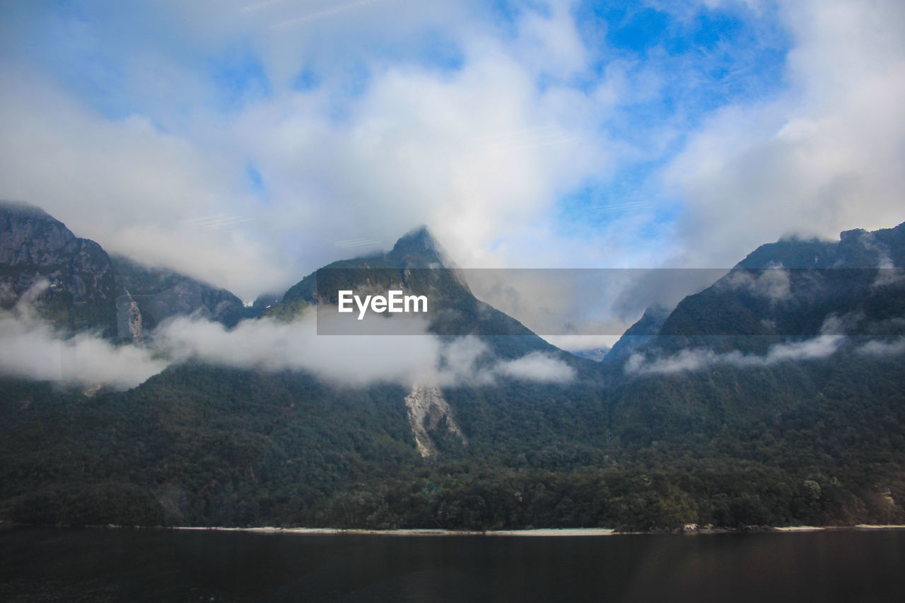 mountain, scenics - nature, beauty in nature, sky, cloud - sky, tranquil scene, tranquility, mountain range, nature, non-urban scene, no people, environment, day, fog, water, idyllic, outdoors, landscape, mountain peak