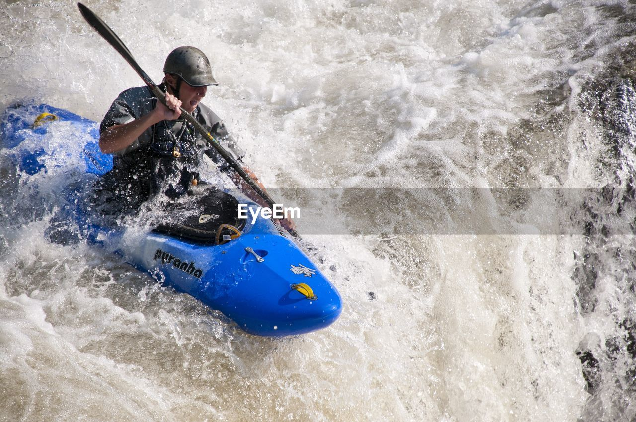 one man only, one person, kayak, adventure, adults only, oar, people, high angle view, day, sports helmet, sport, helmet, only men, rapid, adult, outdoors, nautical vessel, extreme sports, headwear, nature