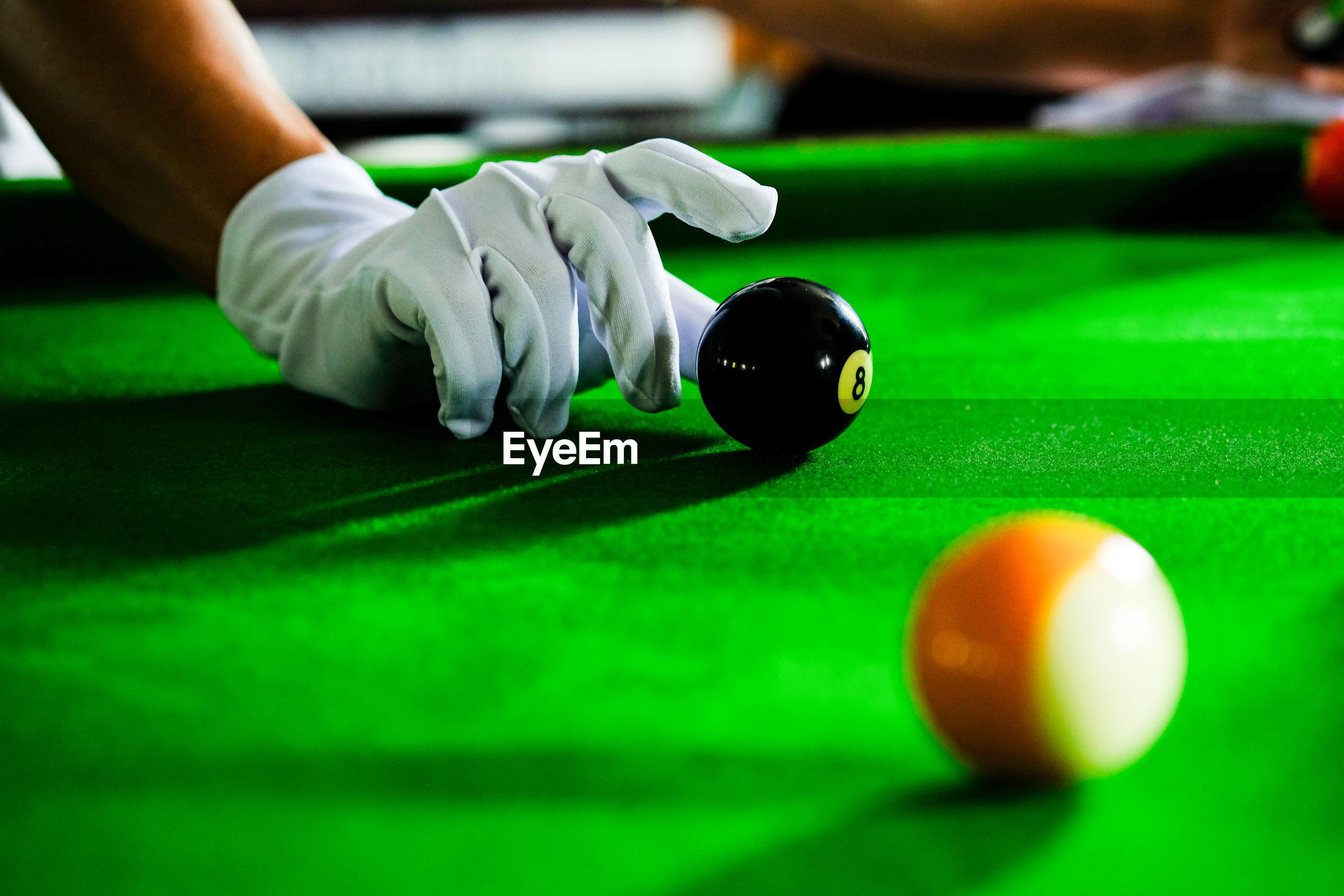 Man playing pool ball on table
