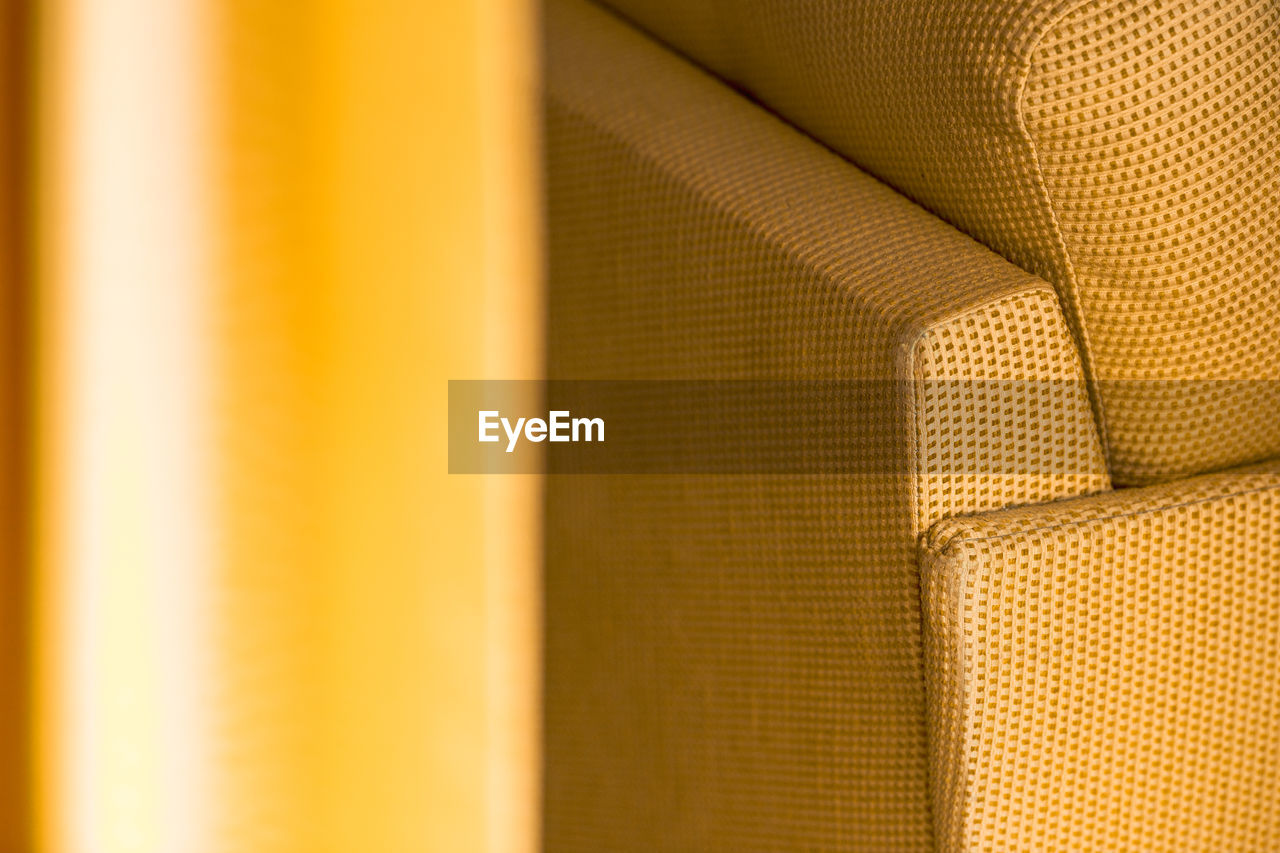 backgrounds, no people, full frame, close-up, textile, yellow, indoors, textured, pattern, selective focus, brown, gold colored, design, curtain, material, clothing, day, metal, orange color, in a row, personal accessory