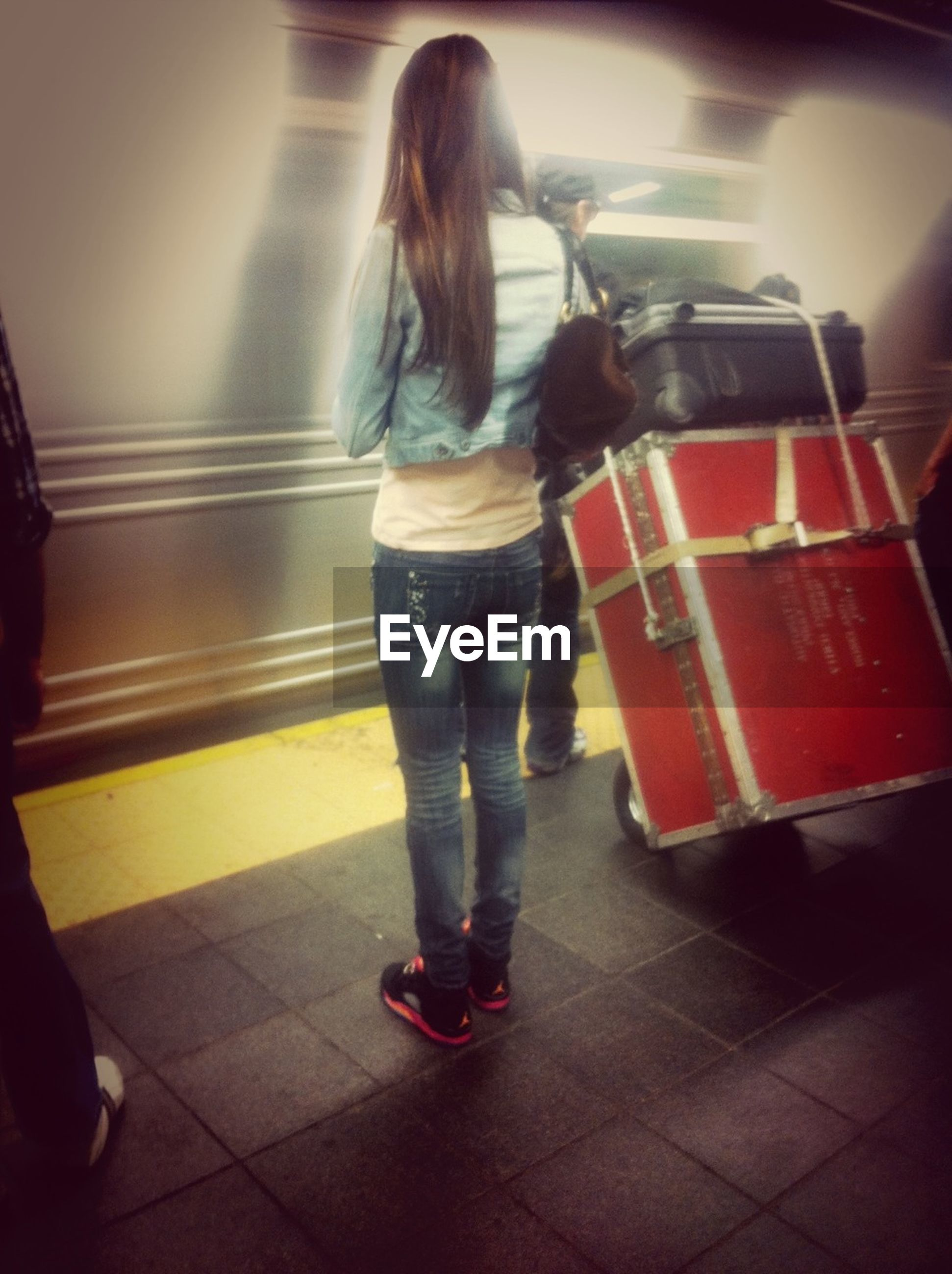 indoors, lifestyles, rear view, person, full length, standing, leisure activity, casual clothing, men, transportation, walking, blurred motion, on the move, travel, motion, red, public transportation, passenger