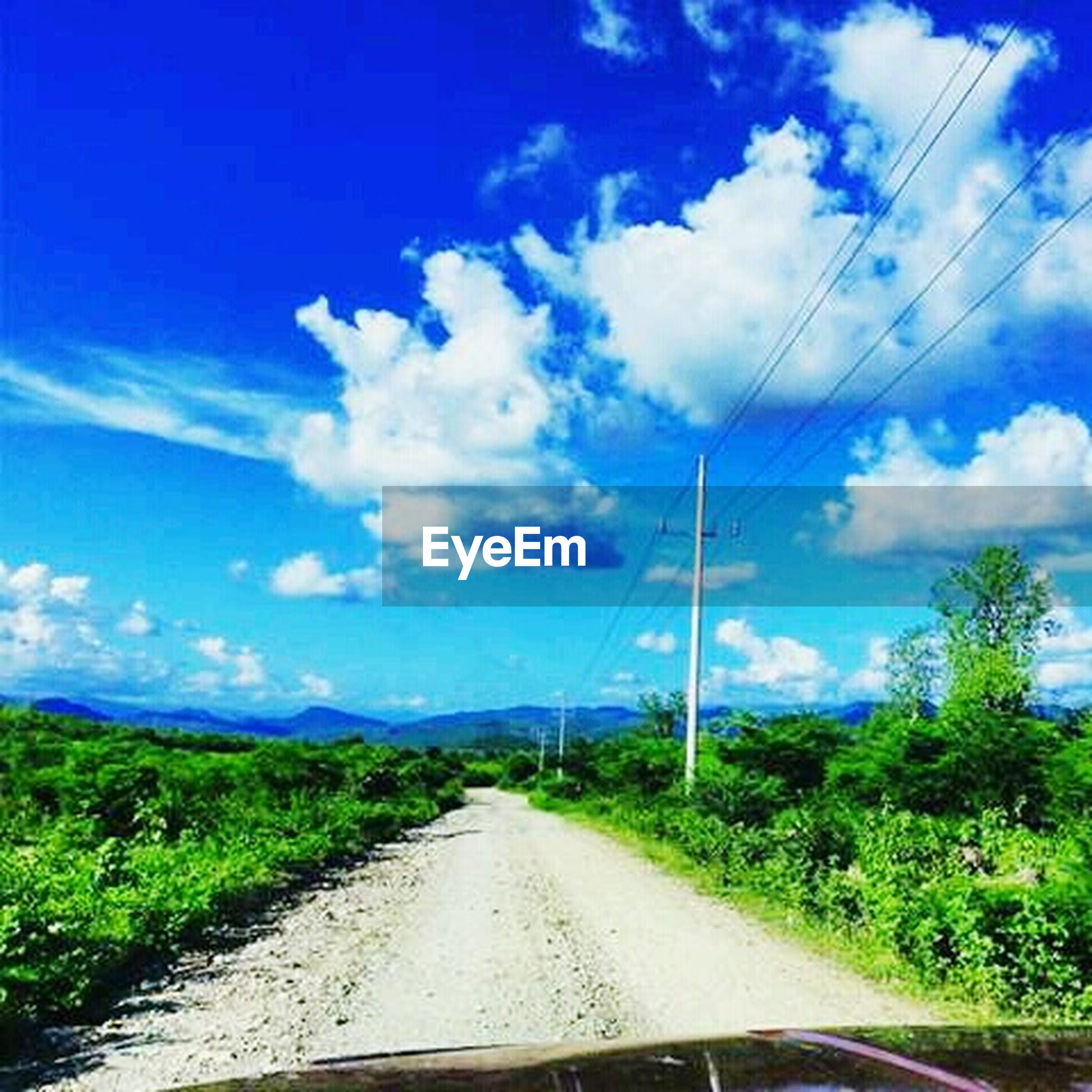 the way forward, transportation, road, sky, diminishing perspective, vanishing point, country road, blue, road marking, cloud - sky, electricity pylon, tree, cloud, power line, landscape, electricity, empty road, empty, nature, countryside