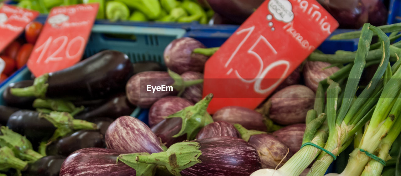 Close-Up Of Vegetables With Price Tag At Market Stall